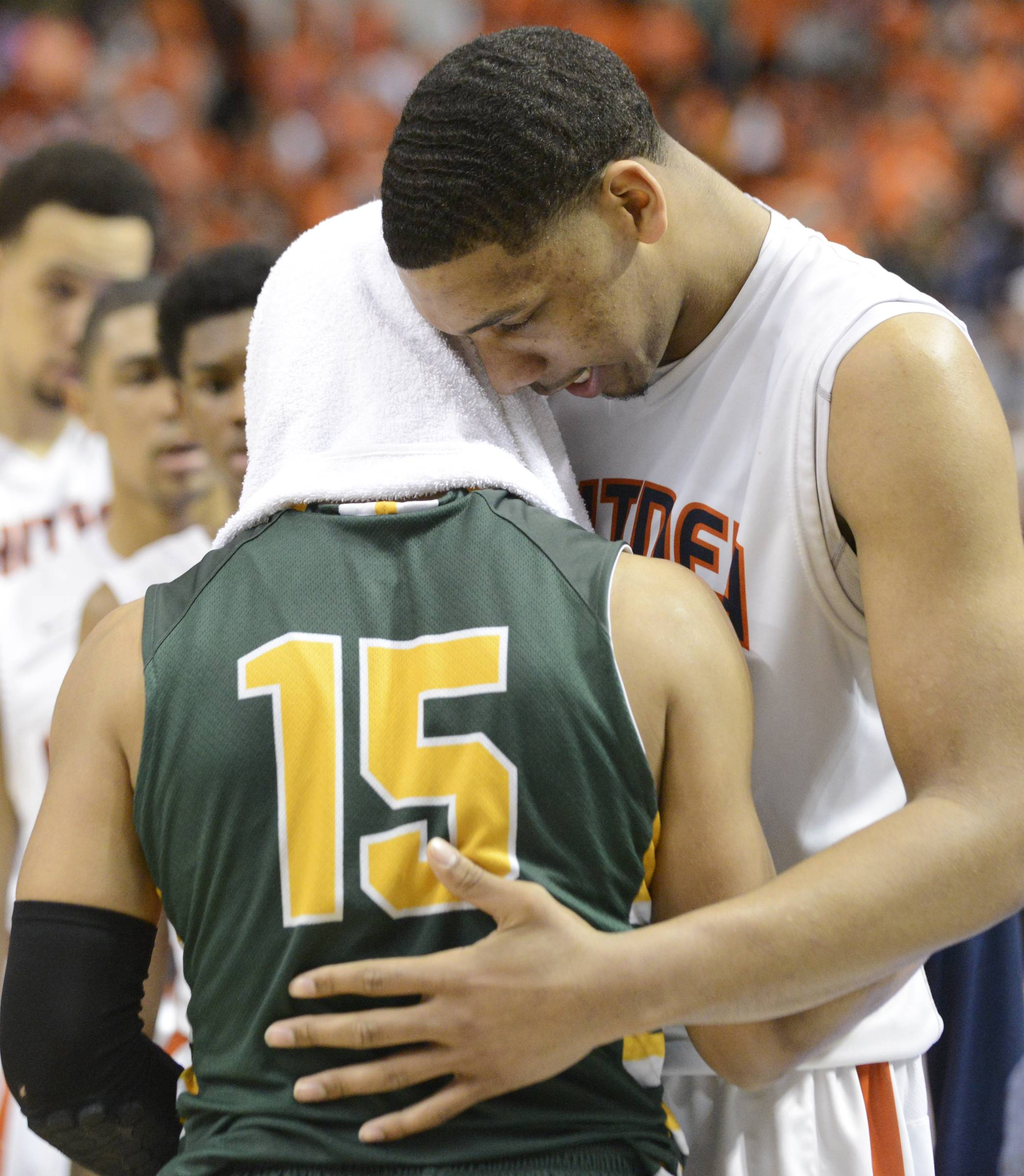 John Starks/jstarks@dailyherald.com  Stevenson's Jalen Brunson and Whitney Young's Jahlil Okafor, right, talk after Whitney Young's victory in the Class 4A state semifinals at Carver Arena in Peoria on Friday.
