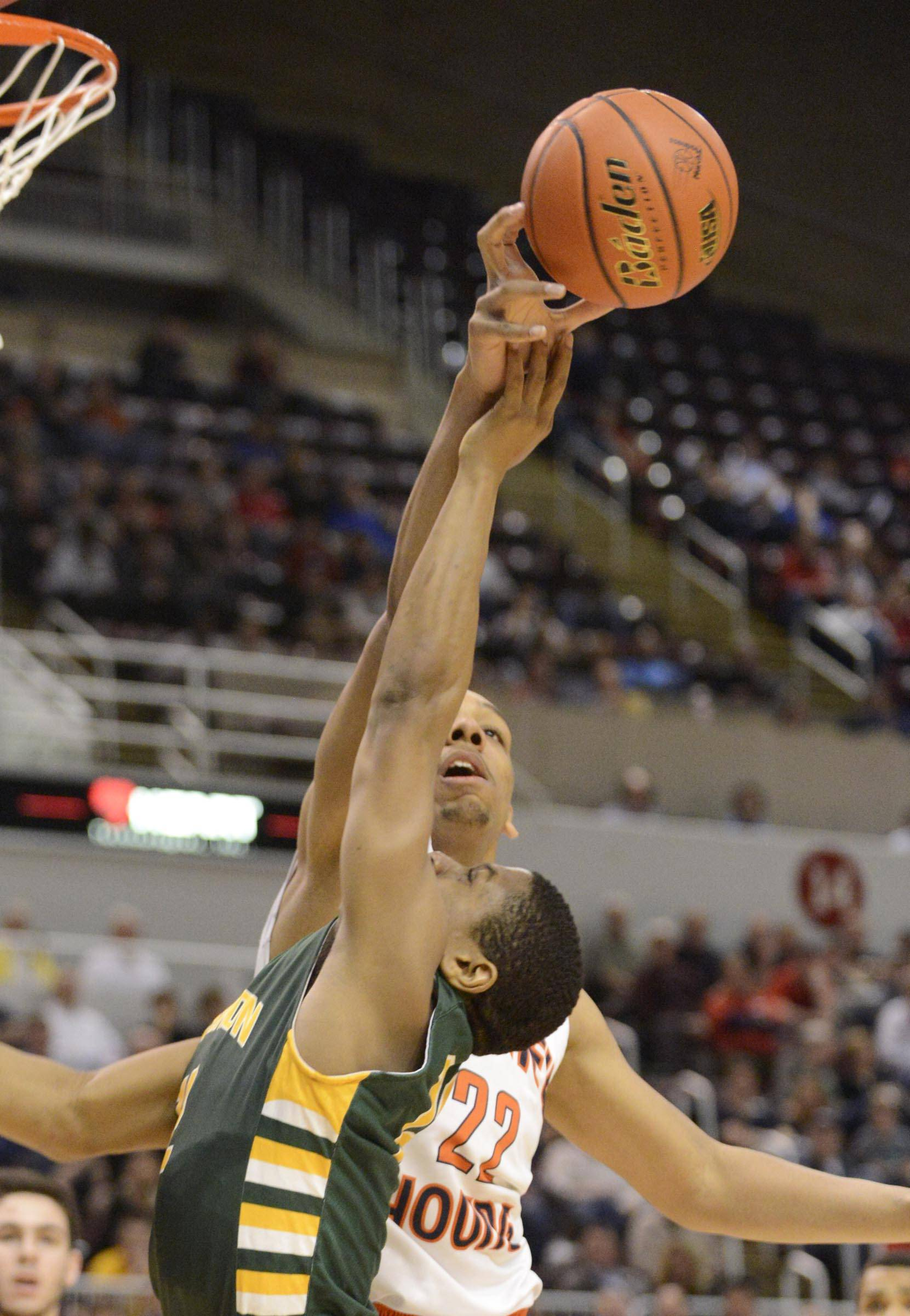 Stevenson's Matthew Johnson is blocked by Whitney Young's Jahlil Okafor in the Class 4A state semifinals at Carver Arena in Peoria on Friday.
