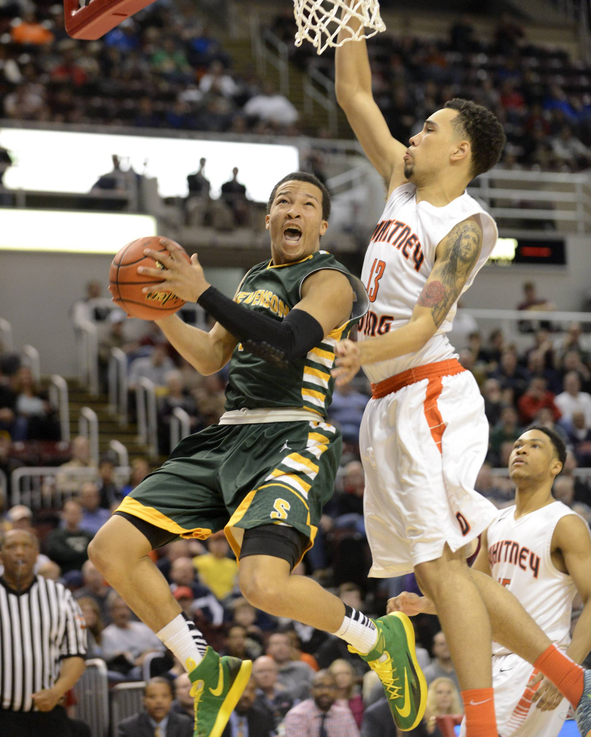 Stevenson's Jalen Brunson scores the first points of the game.