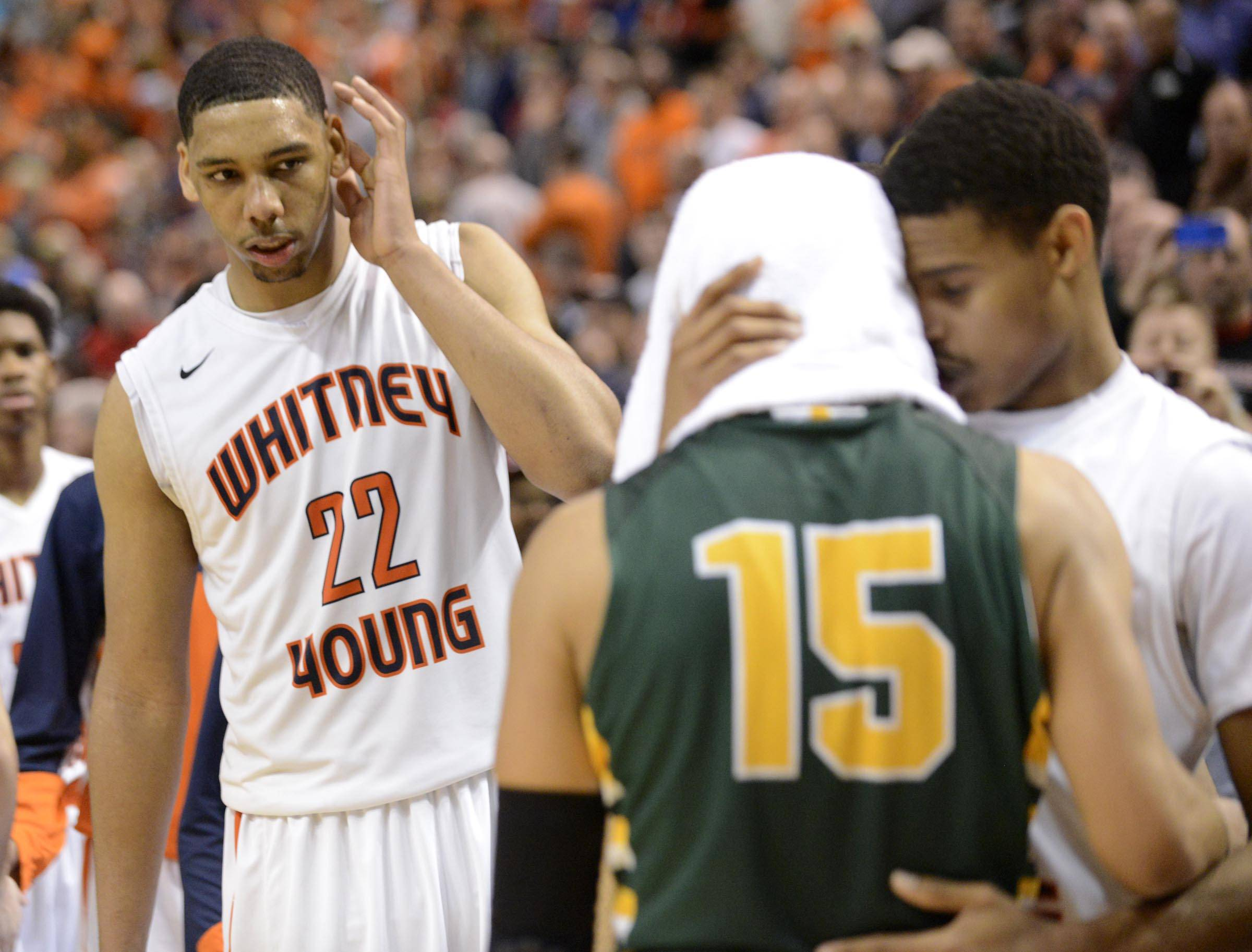 Whitney Young's Jahlil Okafor looks on as teammate Miles Reynolds speaks with Stevenson's Jalen Brunson.