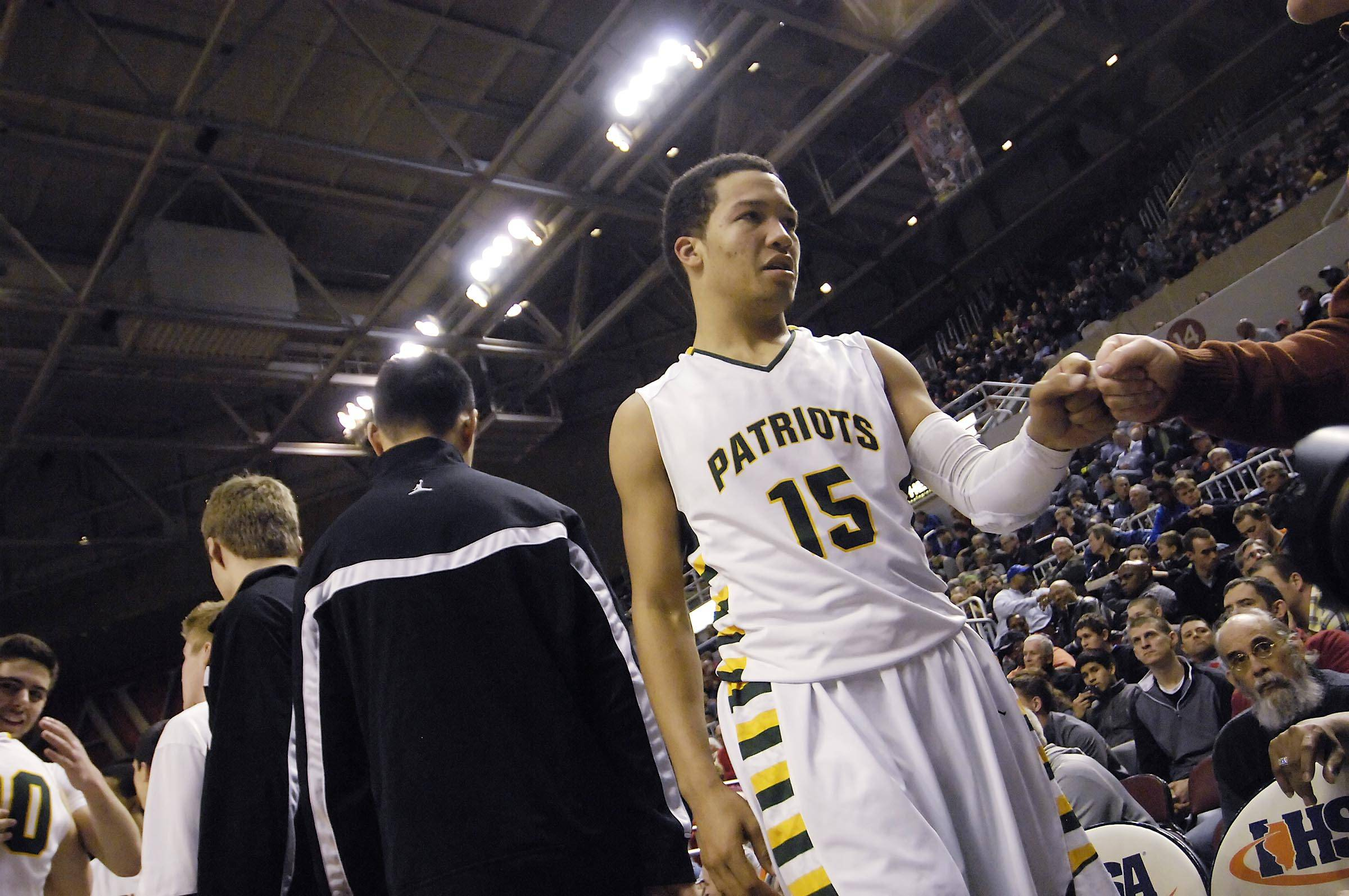 Stevenson's Jalen Brunson comes off the court in the final seconds of the Patriots' 70-63 win over Edwardsville in the Class 4A third-place game at Carver Arena in Peoria on Saturday.