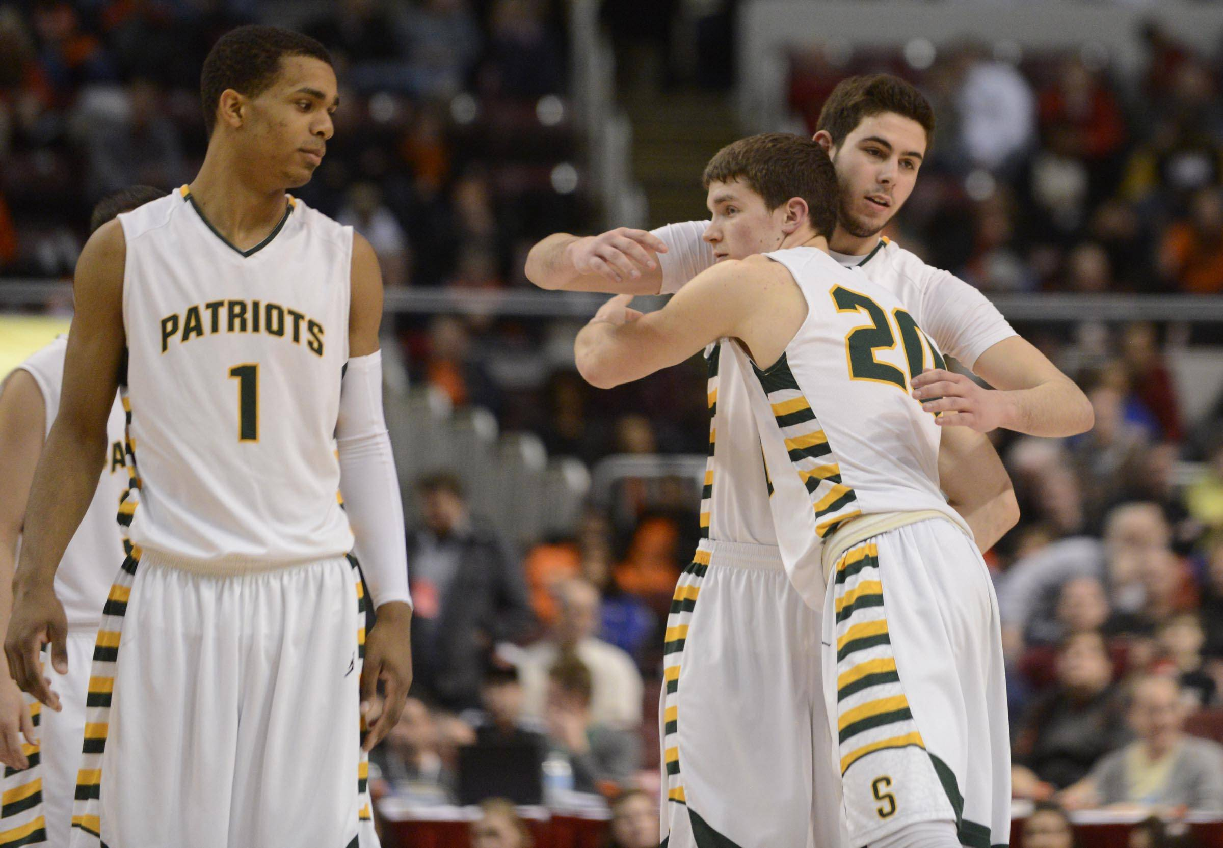 Stevenson's Connor Cashaw watches as Matt Morrissey hugs Parker Nichols before exiting the game in the final seconds of the Patriots' 70-63 win over Edwardsville in the Class 4A third-place game at Carver Arena in Peoria on Saturday.