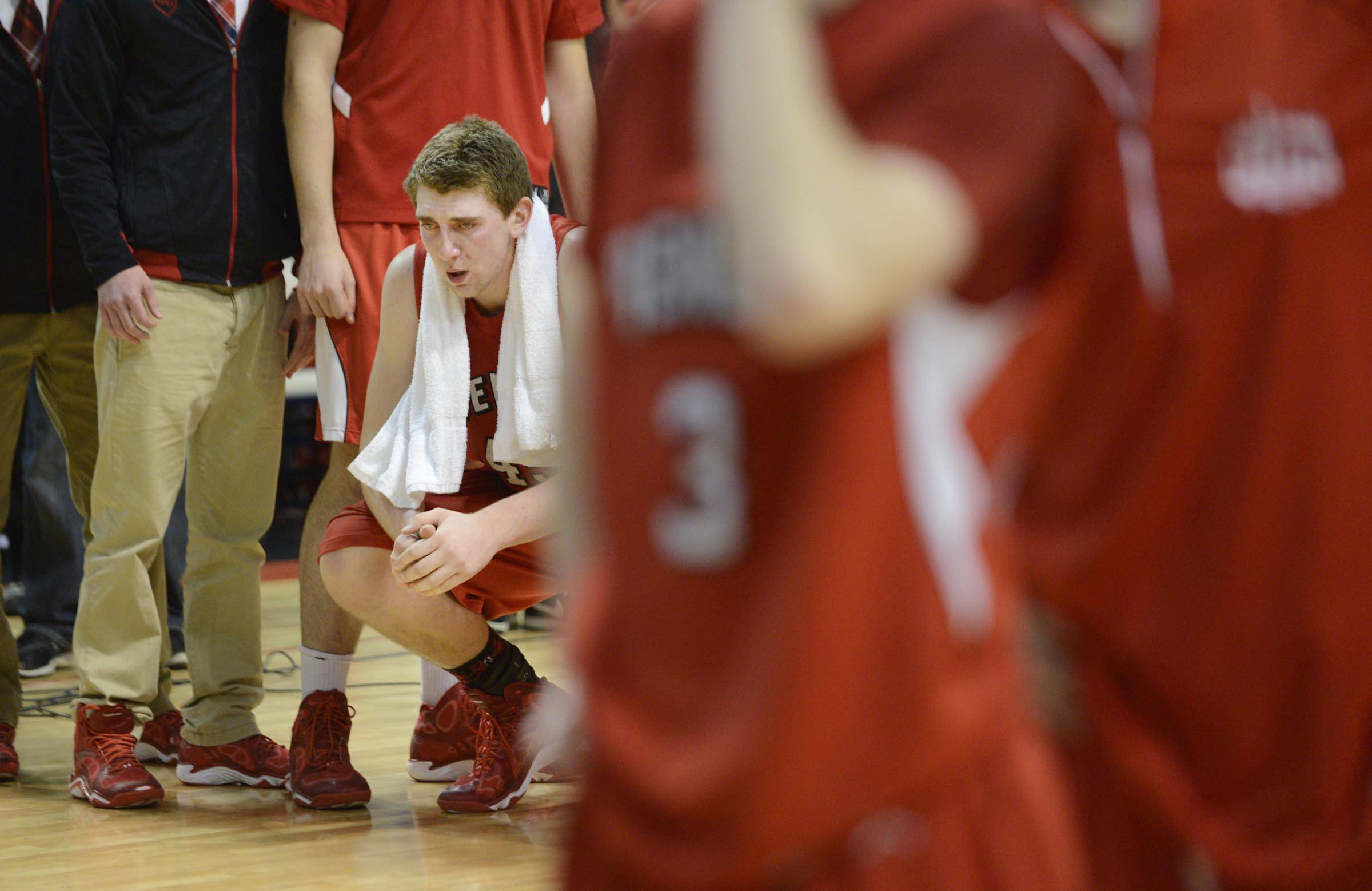 Benet Academy's Sean O'Mara waits with his teammates to reeve their second place trophy after losing to Whitney Young in the Class 4A state championship game at Carver Arena in Peoria Saturday.
