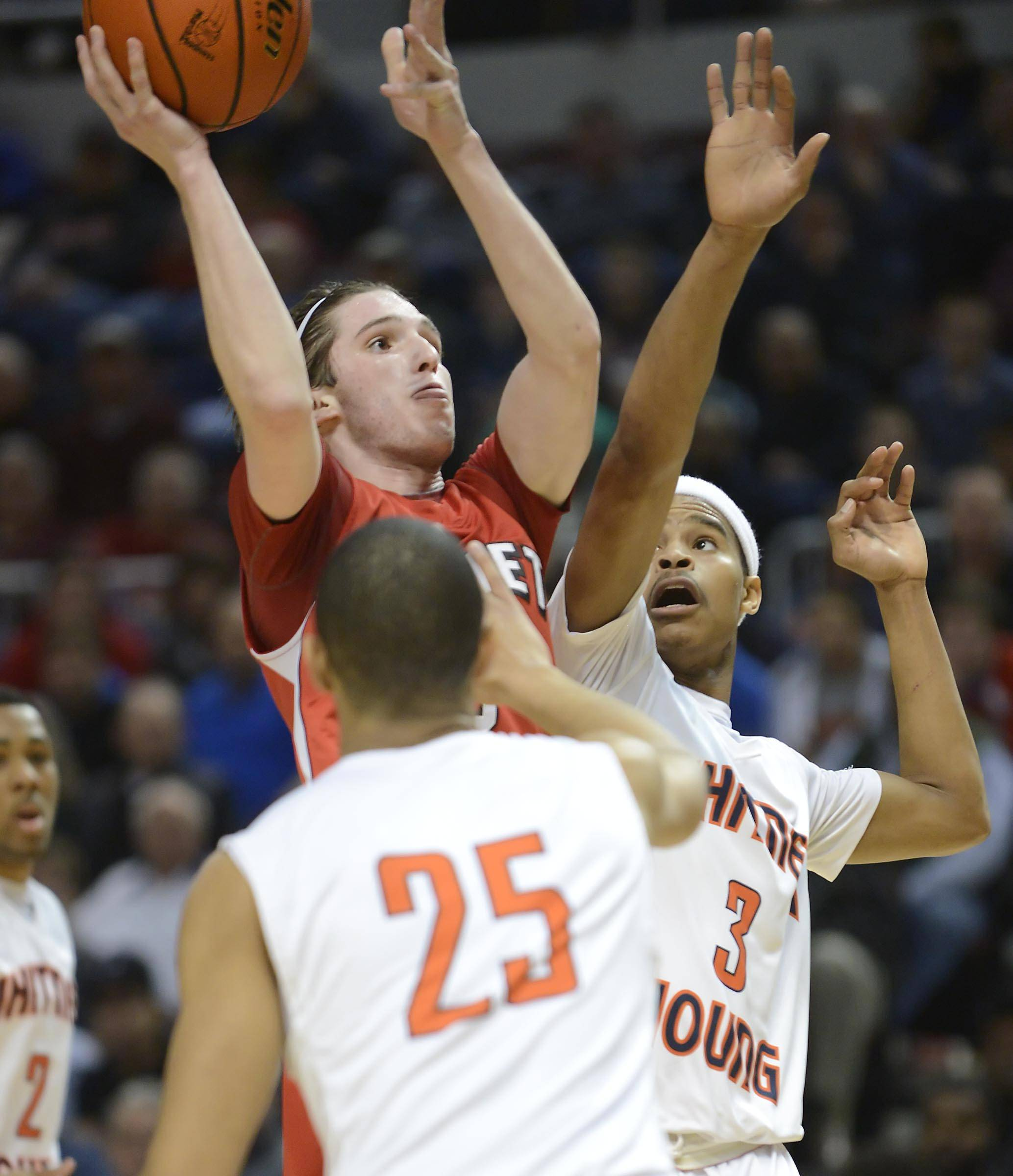 Benet Academy's Collin Pellettieri shoots over Whitney Young's Miles Reynolds and Christian Everett in the Class 4A state championship game at Carver Arena in Peoria Saturday.