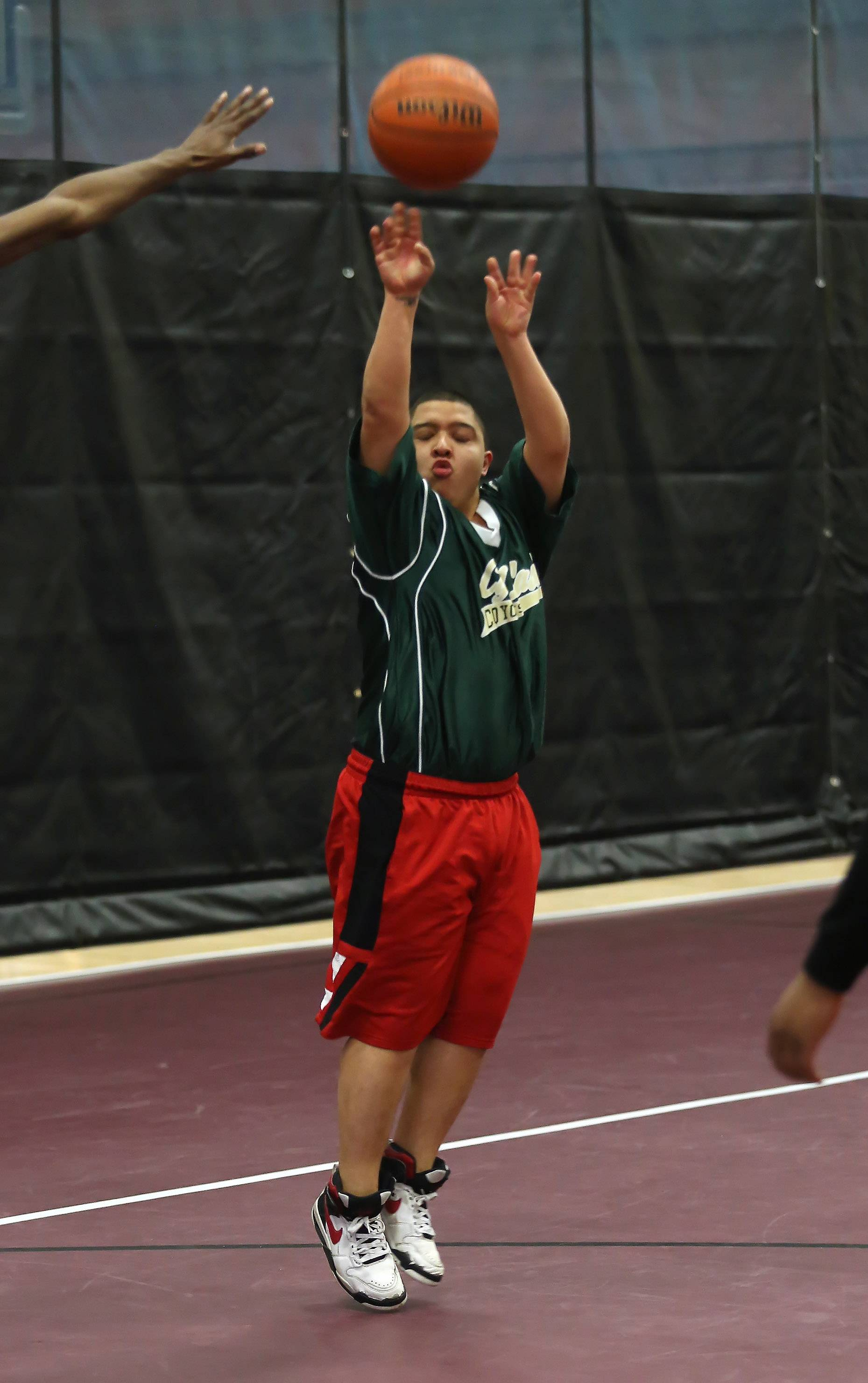 Cyd Lash School's Adrian Almazan of Gages Lake shoots from outside against Allendale School of Lake Villa during Sunday's Chicago Area Alternative Education League basketball tournament at Forest View Education Center in Arlington Heights. Almazan designed the logo on this year's T-shirts for the tournament.