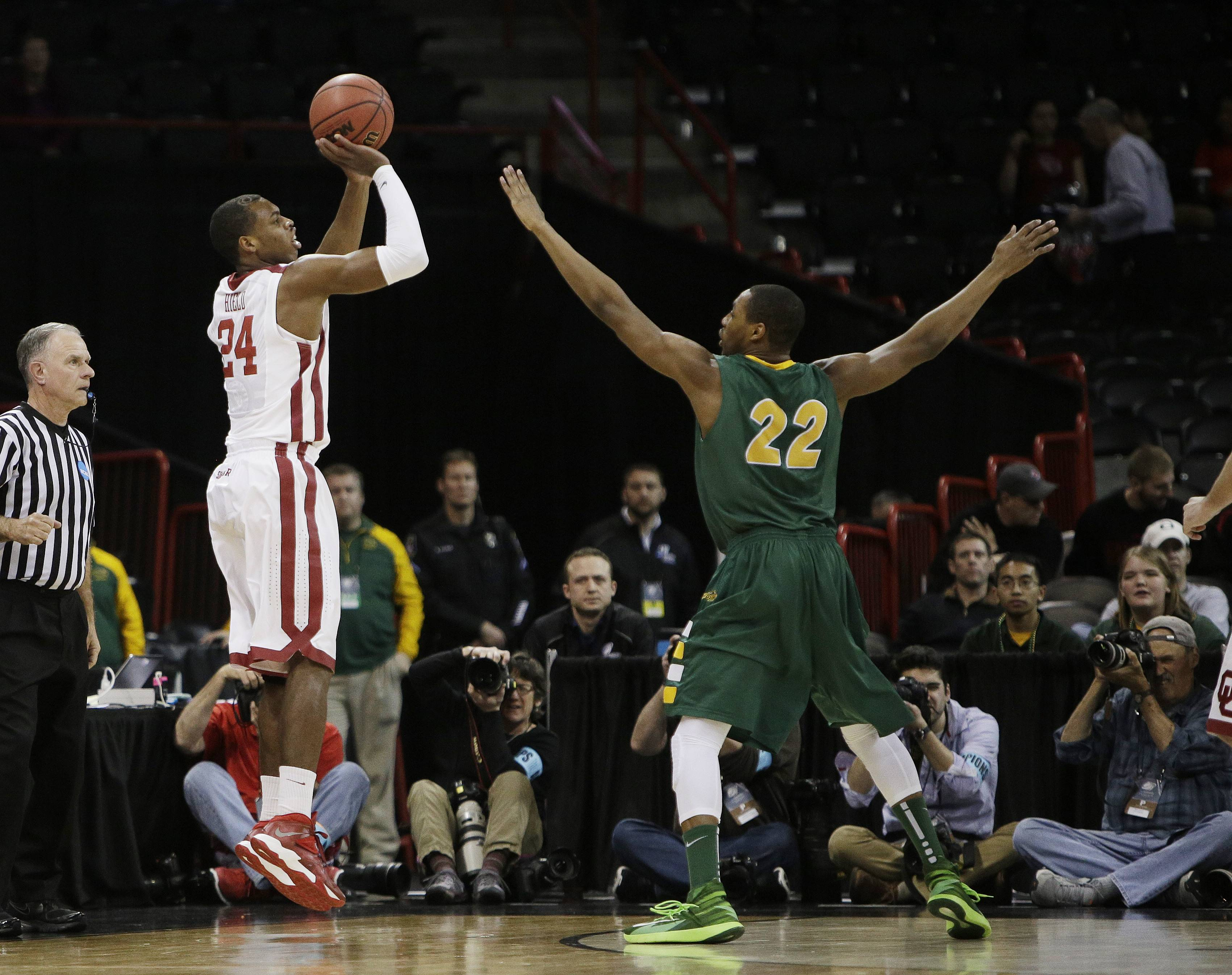 Oklahoma's Buddy Hield (24) shoots as North Dakota State's Kory Brown (22), an Elgin High graduate, defends during a second-round game of the NCAA Tournament in Spokane, Wash., last week.