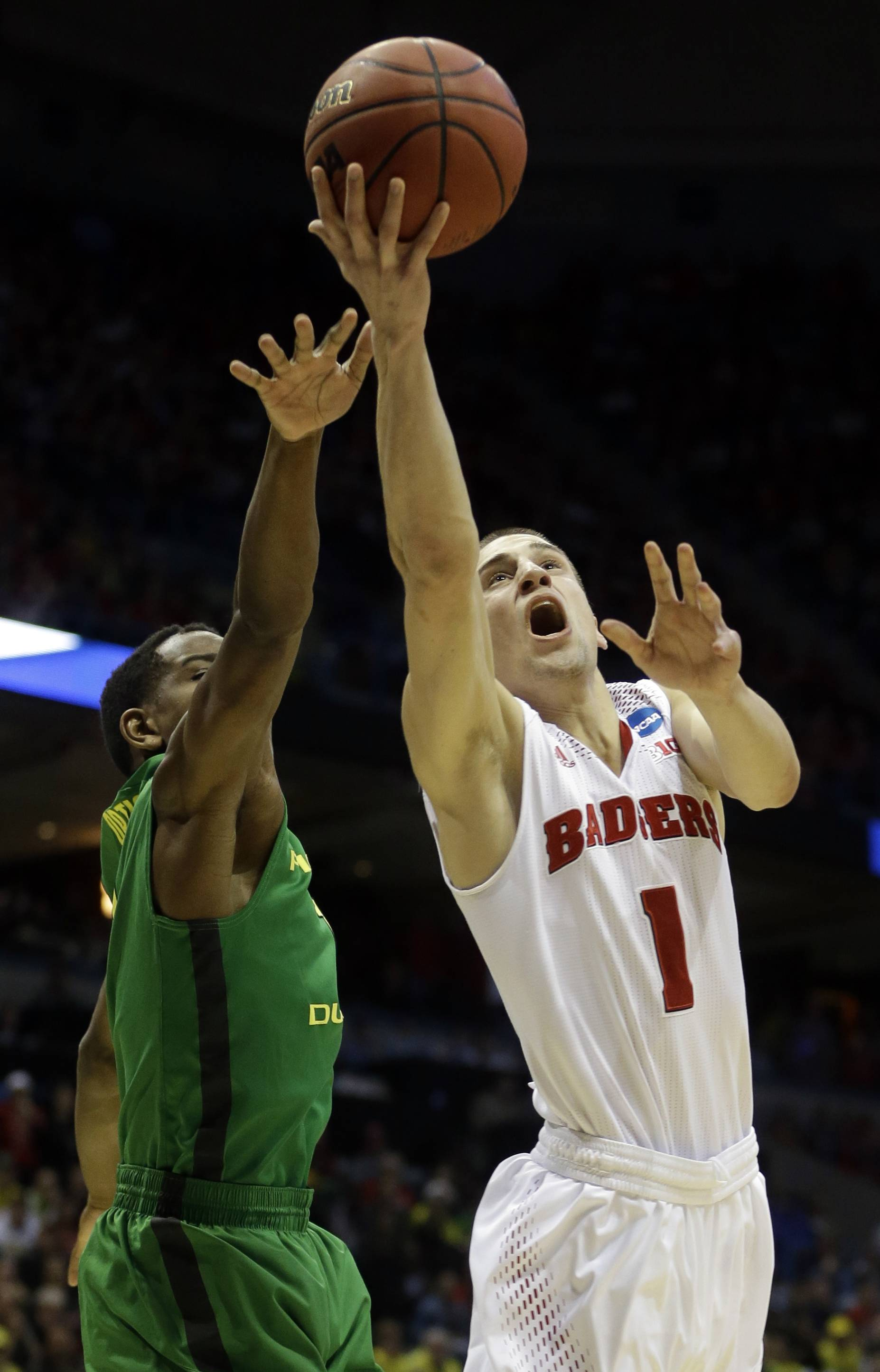 Wisconsin guard Ben Brust goes up for a shot against Oregon guard Dominic Artis during the second half of NCAA play March 22 in Milwaukee.