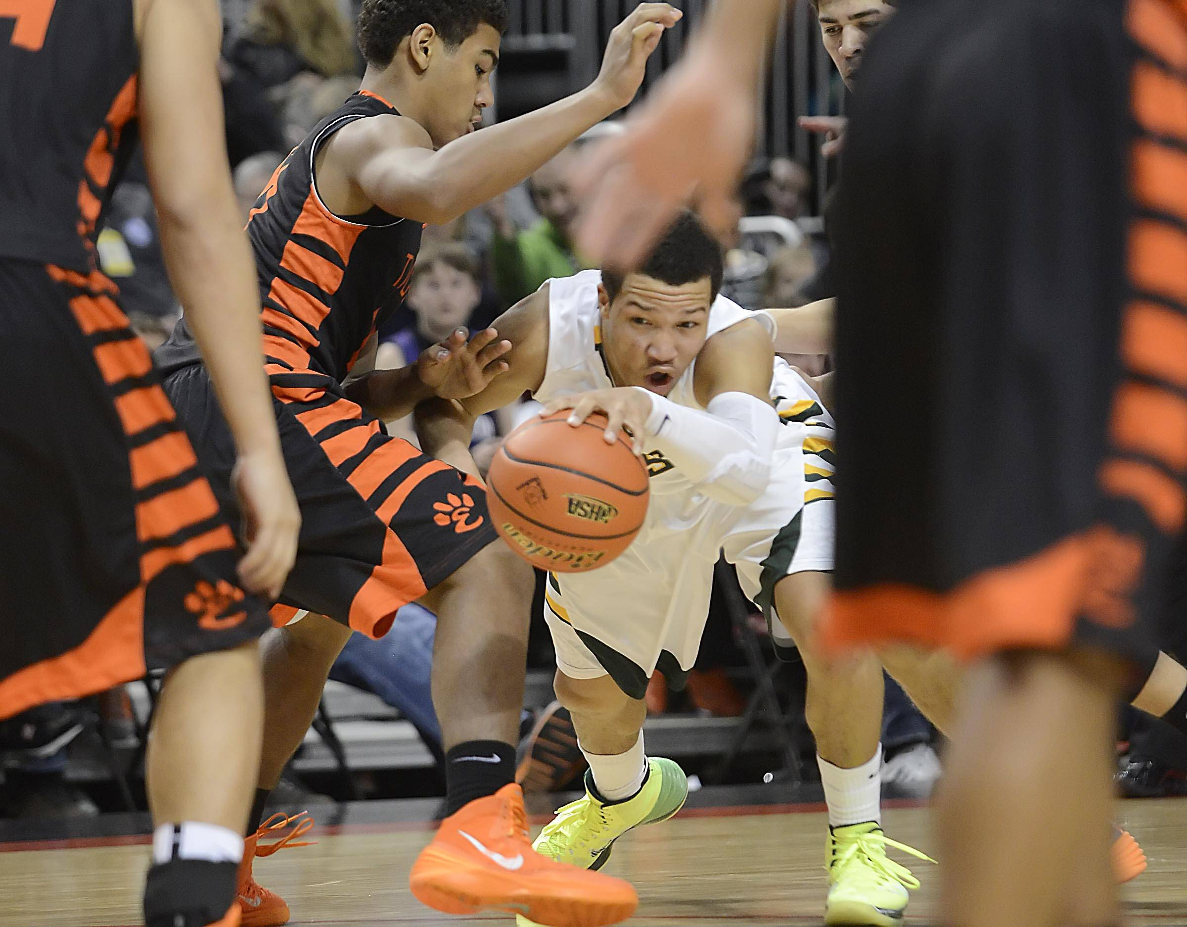 Stevenson's Jalen Brunson fights battles through the Edwardsville defenders in last season's third-place game in the Class 4A state tournament.