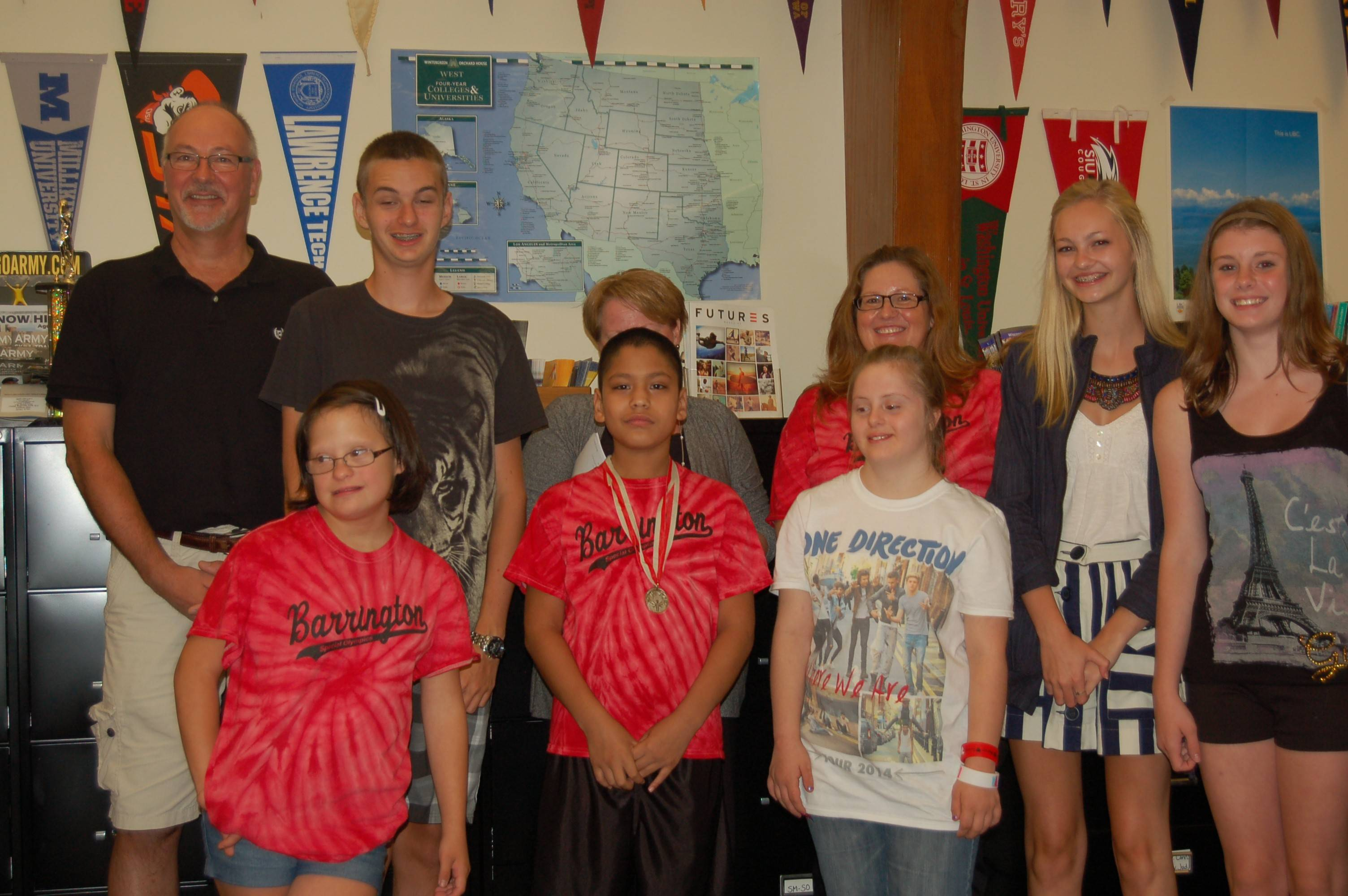 Some members of the Barrington High School Special Olympics sports teams, including student athletes, head coaches and peer coaches, pose for a photo during a Barrington Area Unit District 220 school board meeting at Barrington High School Tuesday night.