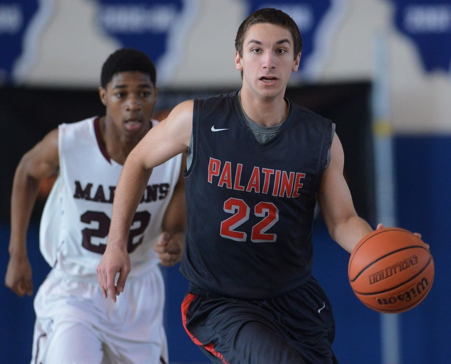 Palatine's Matthew Ulrich leads a fastbreak against Elgin during the Martin Luther King Classic tournament at Lake Zurich on Saturday.