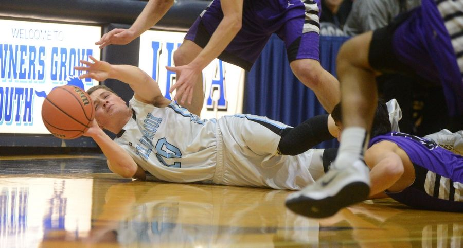 Jake Bruns of Willowbrook scrambles for the ball during the Class 4A Downers Grove South boys basketball regional game Wednesday.