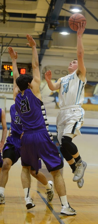 Jake Bruns of Willowbrook takes a shot over Jack Fallbacher of Downers Grove north during the Class 4A Downers Grove South boys basketball regional game Wednesday.