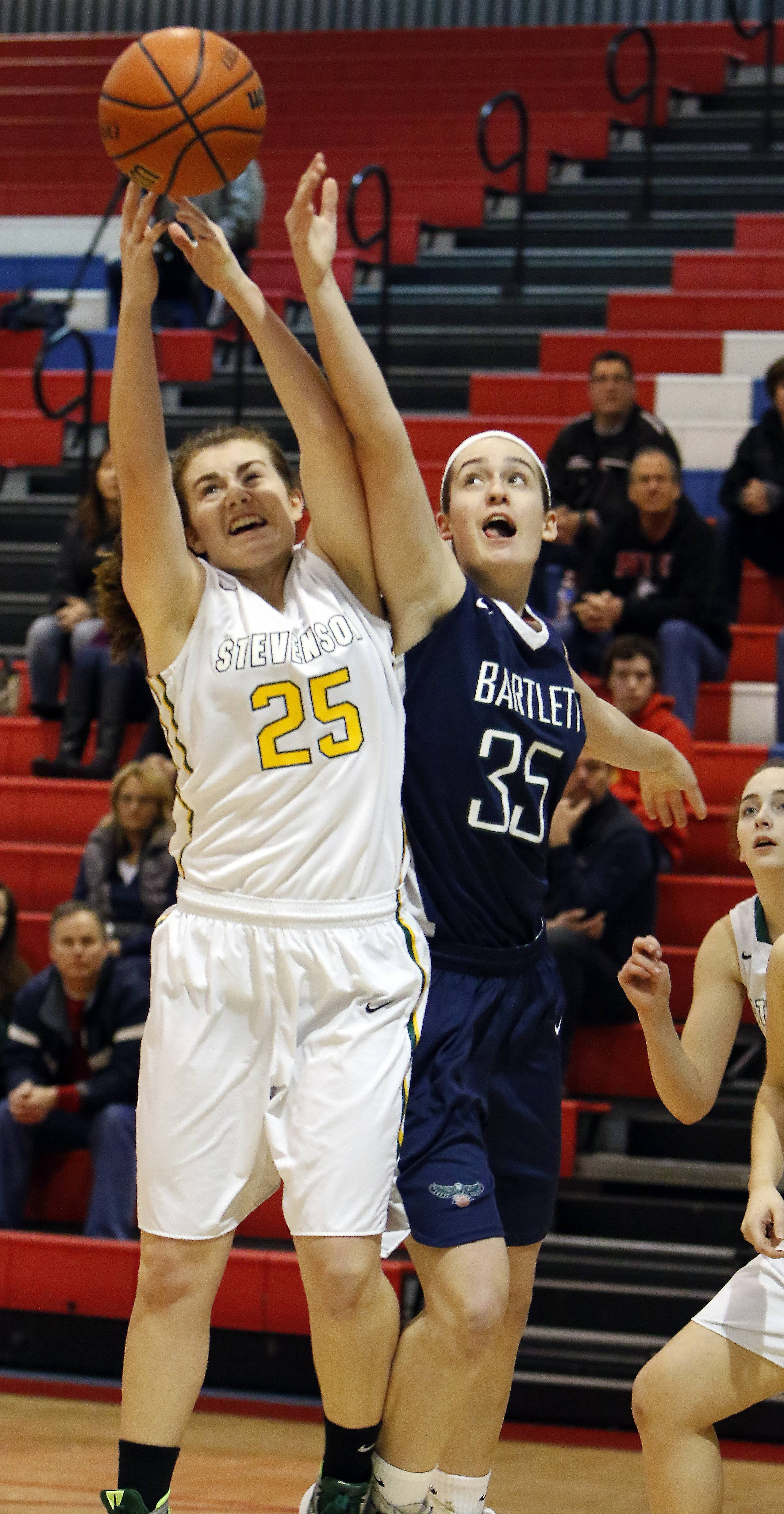 Bartlett's Kelly Harris battles Stevenson's Ashley Richardson for a rebound Saturday at Dundee-Crown.