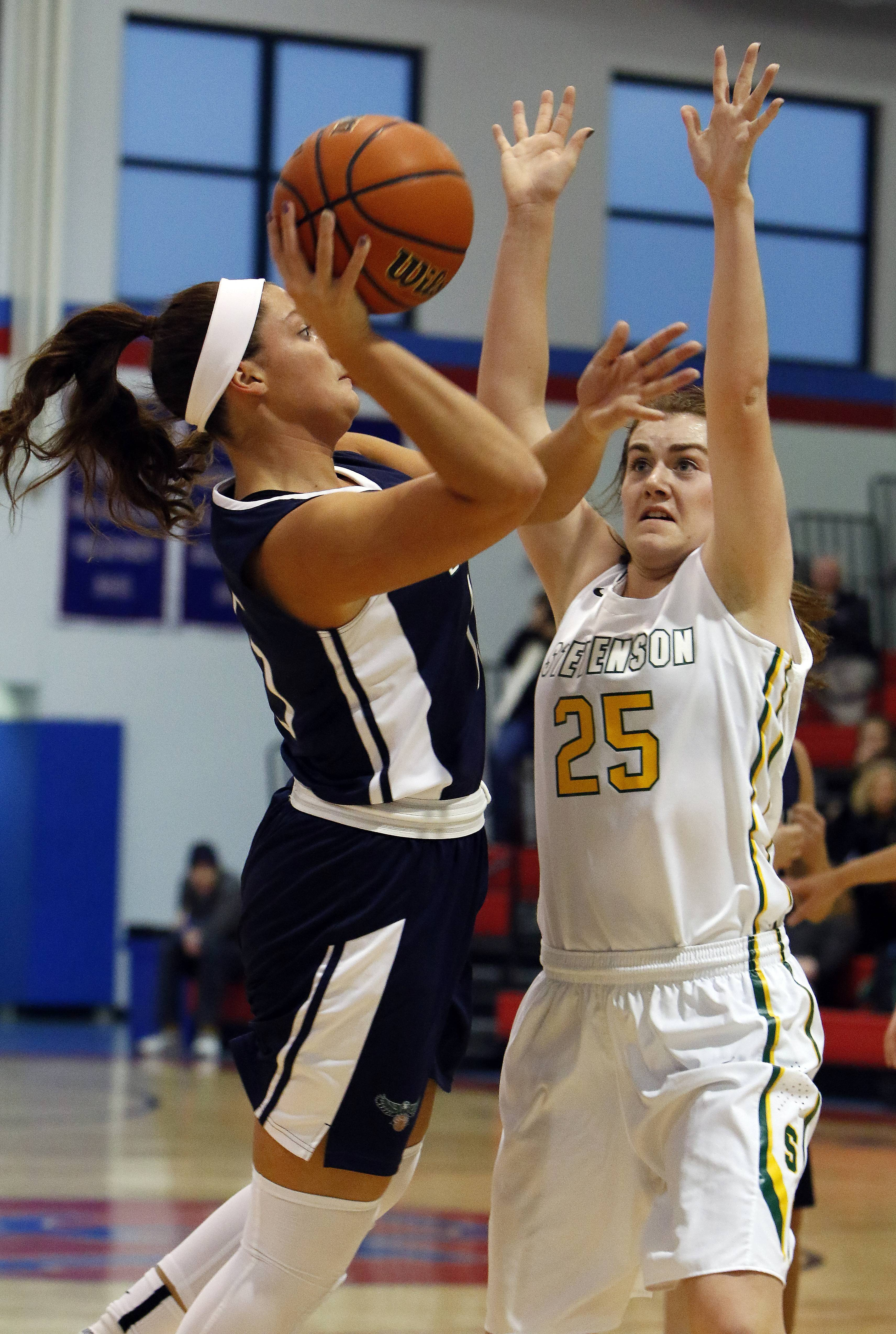 Bartlett's Kaitlin Brohan throws up a shot over Stevenson's Ashley Richardson at Dundee-Crown Saturday.