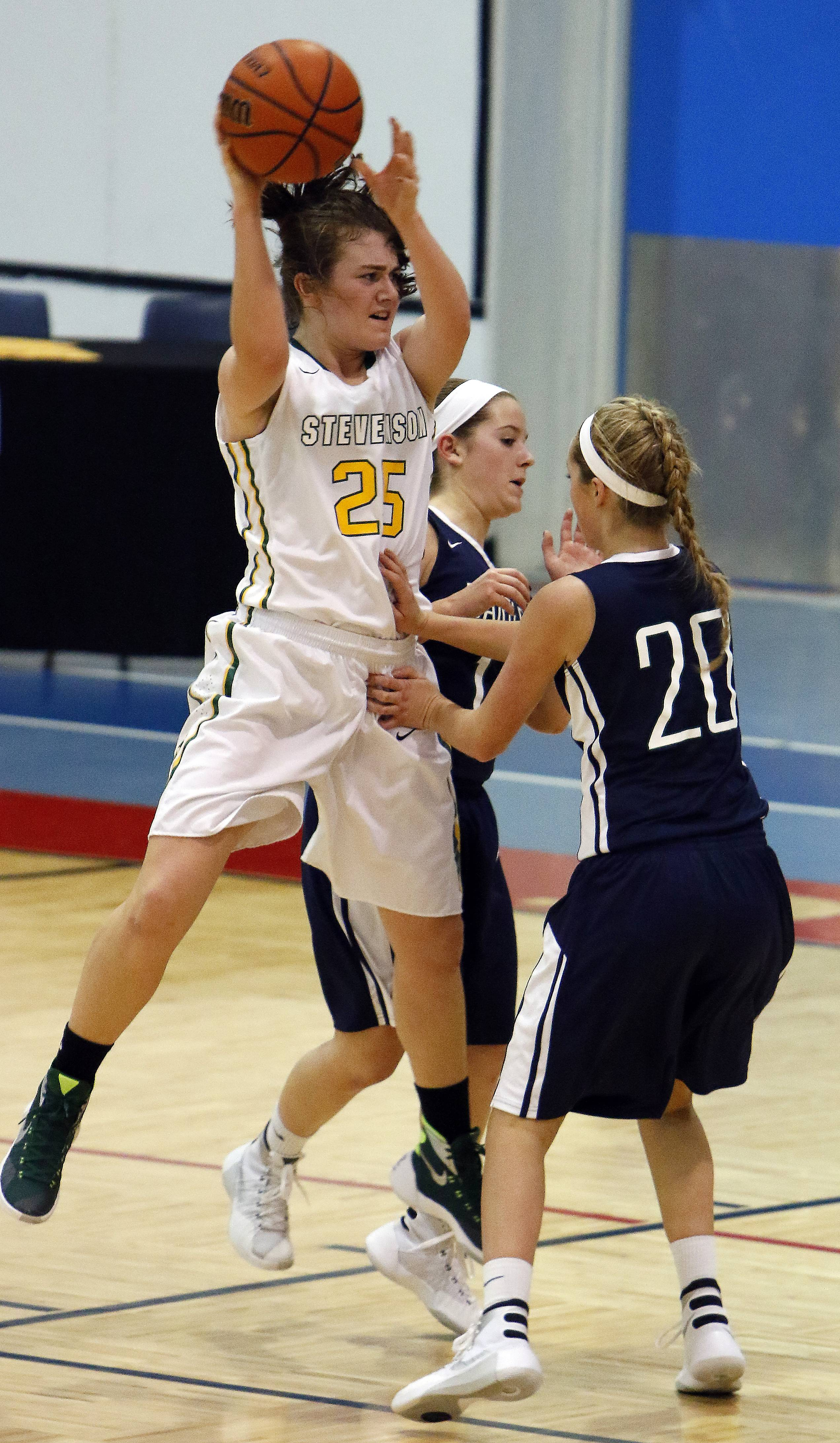 Stevenson's Ashley Richardson looks for an open teammate against Bartlett during girls basketball at Dundee-Crown Saturday in Carpentersville.