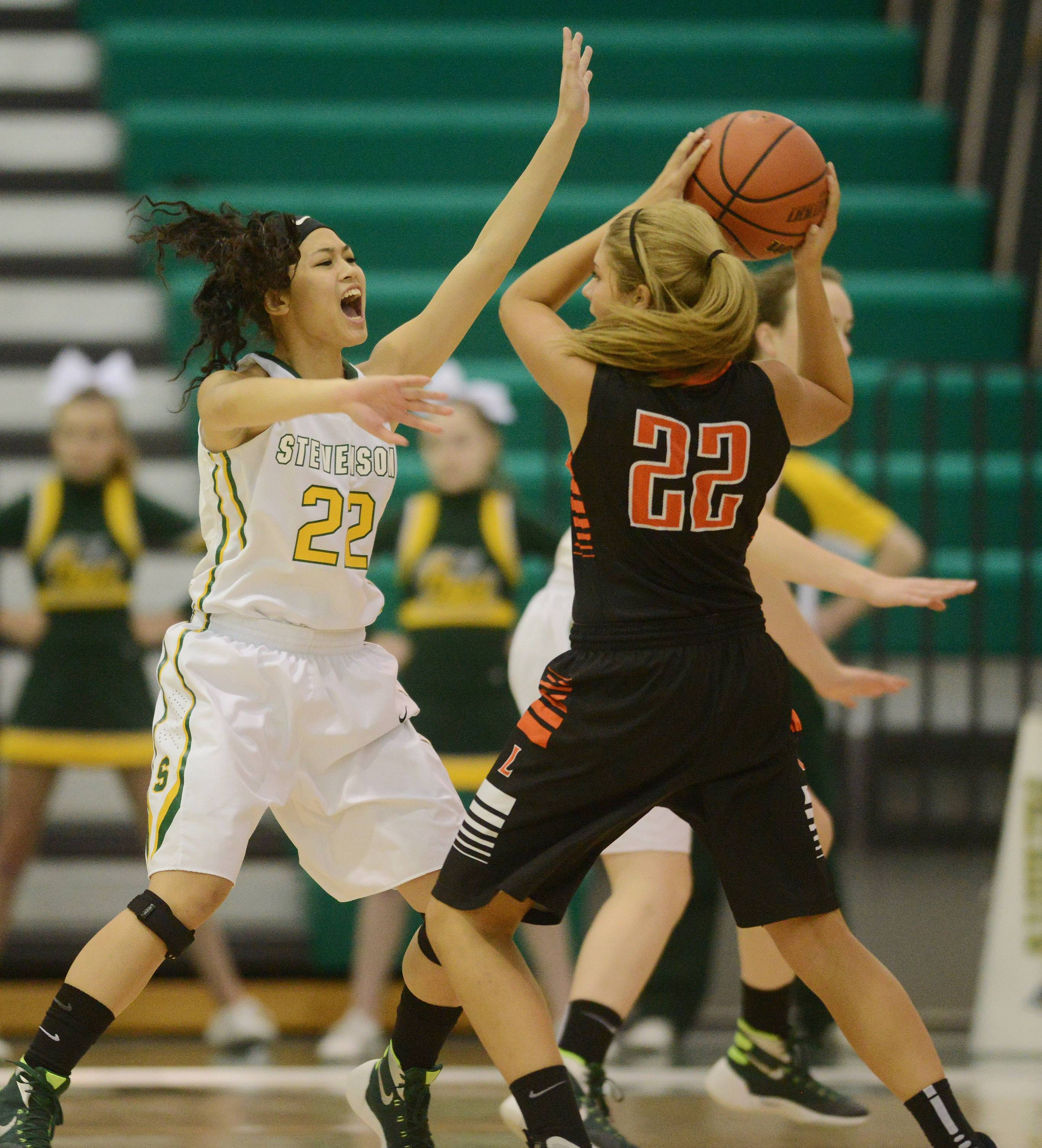 Stevenson's Janine Fajardo, left, guards Libertyville's Riley Weis during Saturday's game in Lincolnshire.