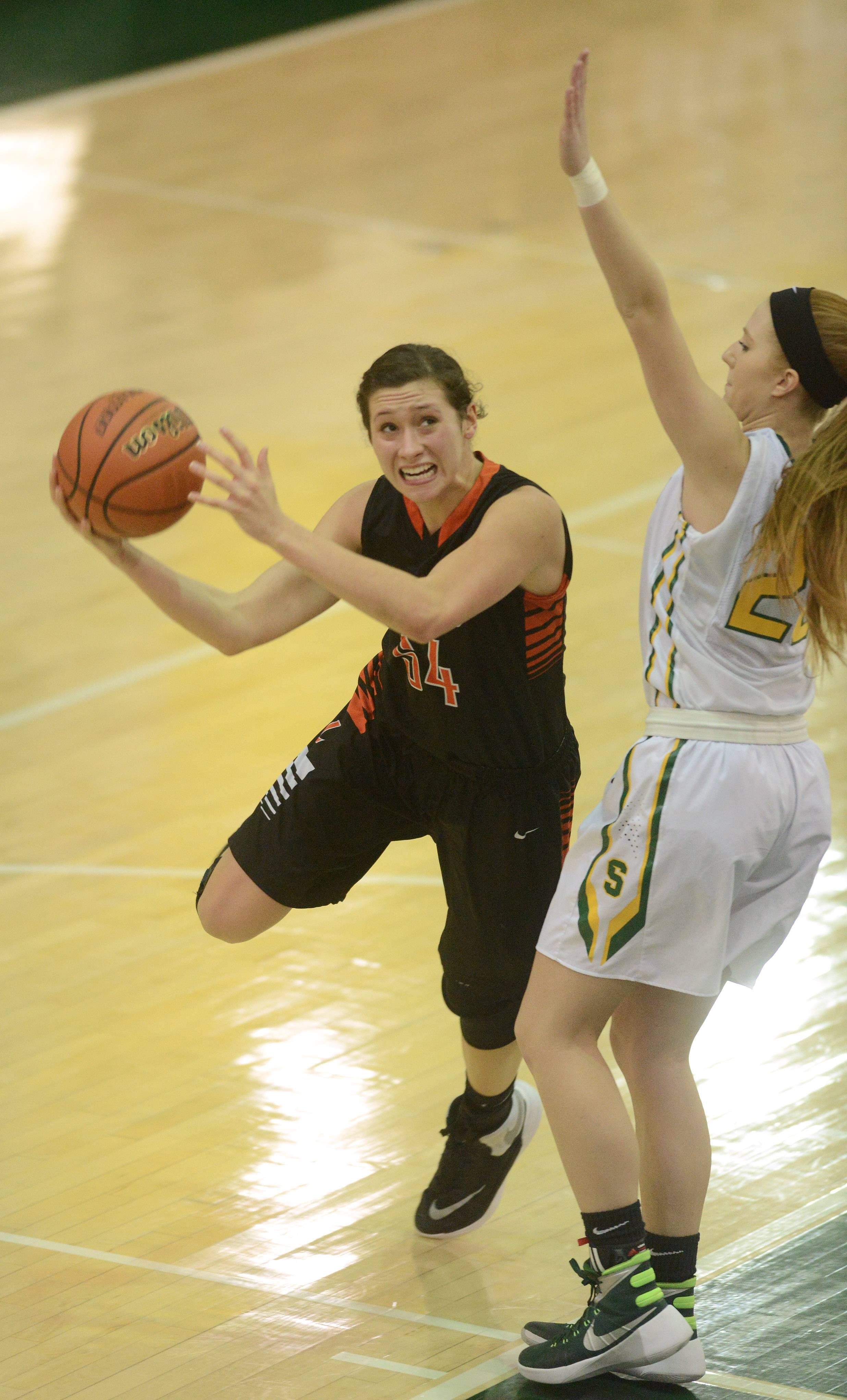 Libertyville's Claire Keefe drives to the basket against Stevenson's Jessica Burke during Saturday's game in Lincolnshire.