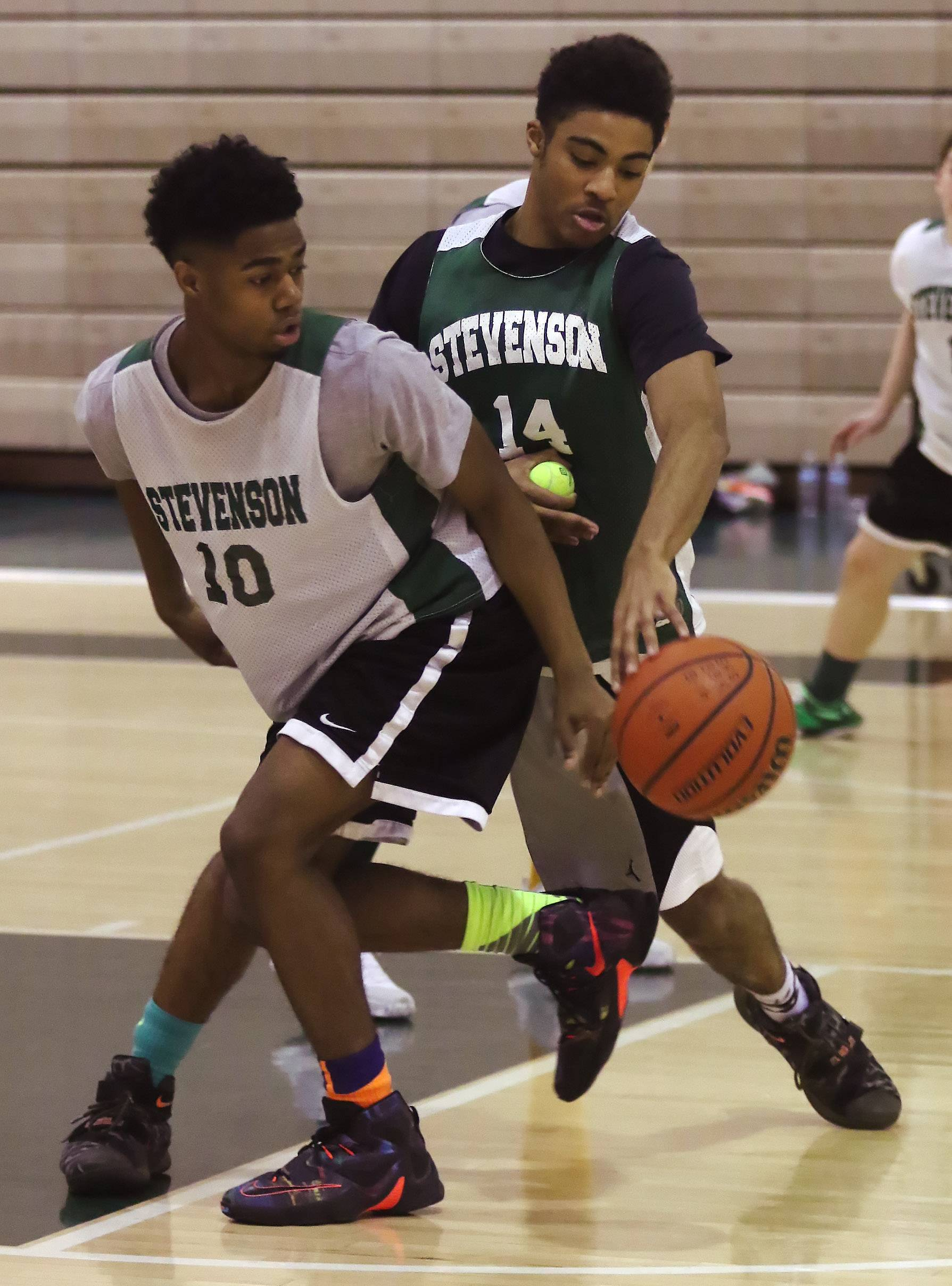 Stevenson's Willie Herenton (14) steals the ball from teammate Tyrek Washington (10) during Patriots practice Thursday.