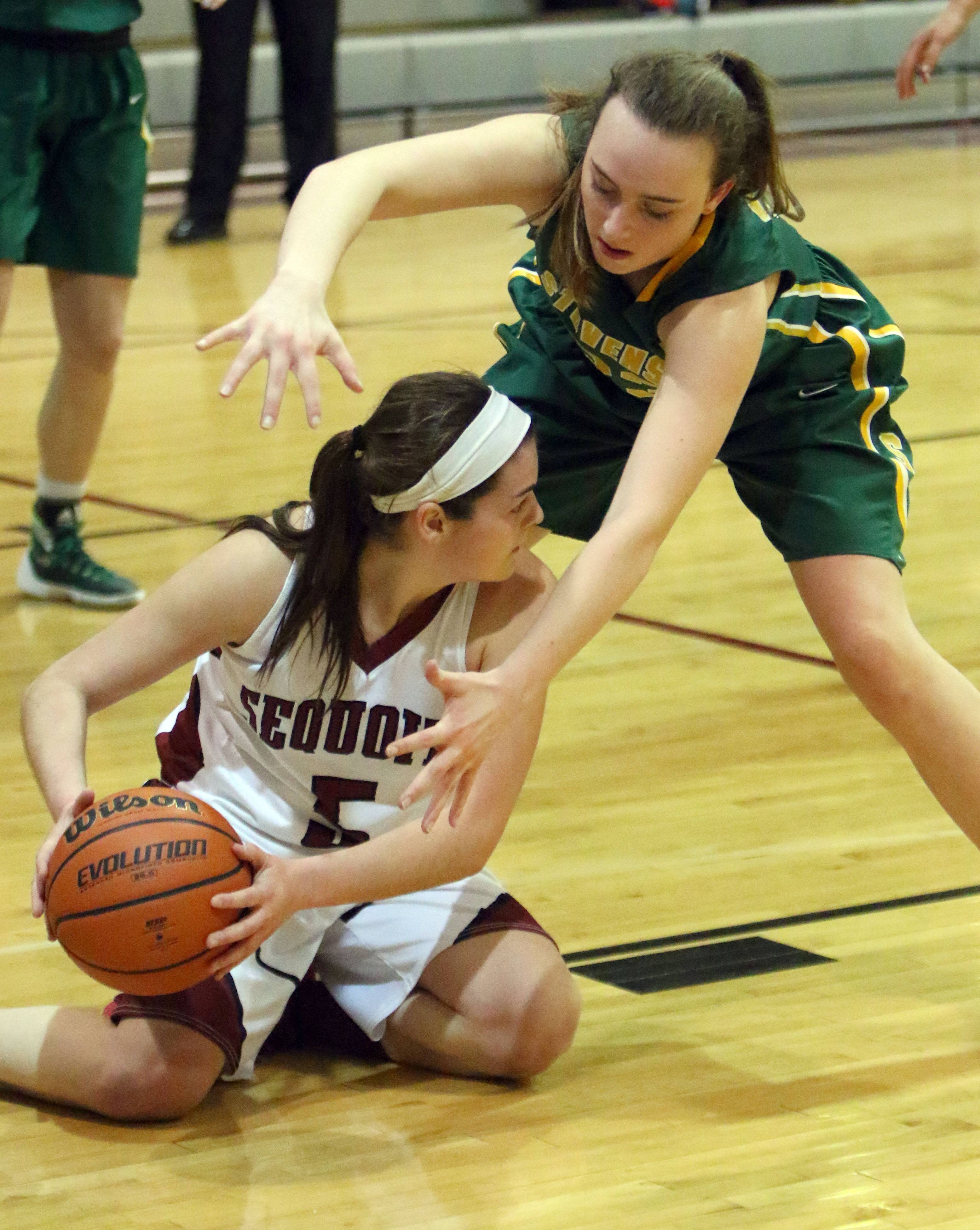 Antioch's Amy Reiser, left, and Stevenson's Klaire Steffens battle for a lose ball during the NSC title game Wednesday night at Antioch.