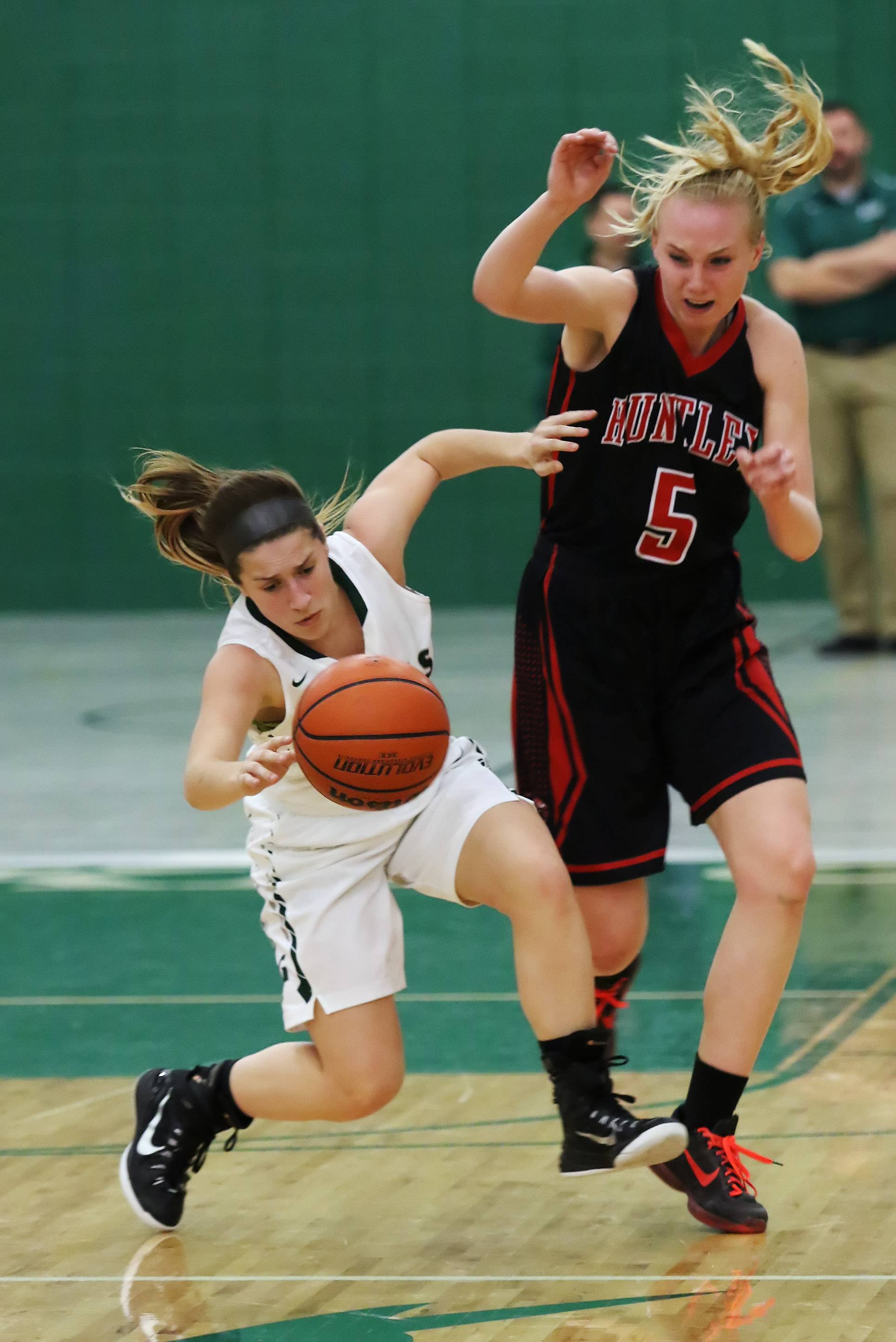 Grayslake Central guard Quin Garbett is fouled by Huntley forward Morgan Clausen on Thursday at Grayslake Central.
