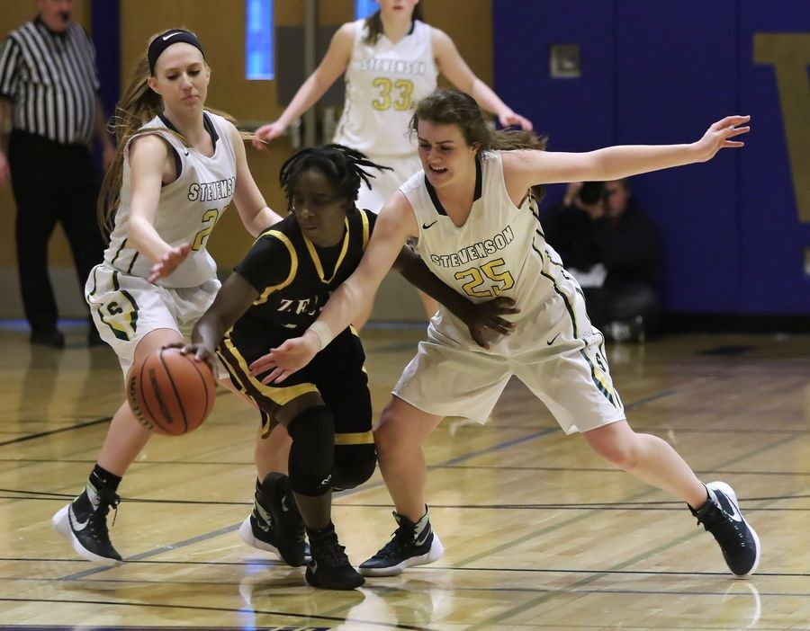 Stevenson players Jessica Burke, left, and Ashley Richardson swarm Zion-Benton guard Ledallia Maggett in the fourth quarter Thursday at Wheeling.