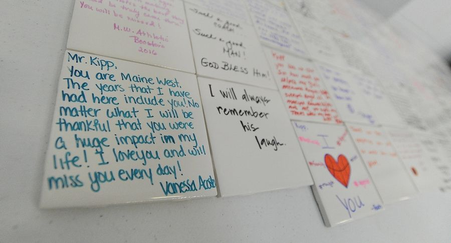 Many visitors wrote personal messages about legendary Maine West girls basketball coach Derril Kipp on tiles that eventually will be displayed in the gym. Kipp, 71, died July 5.