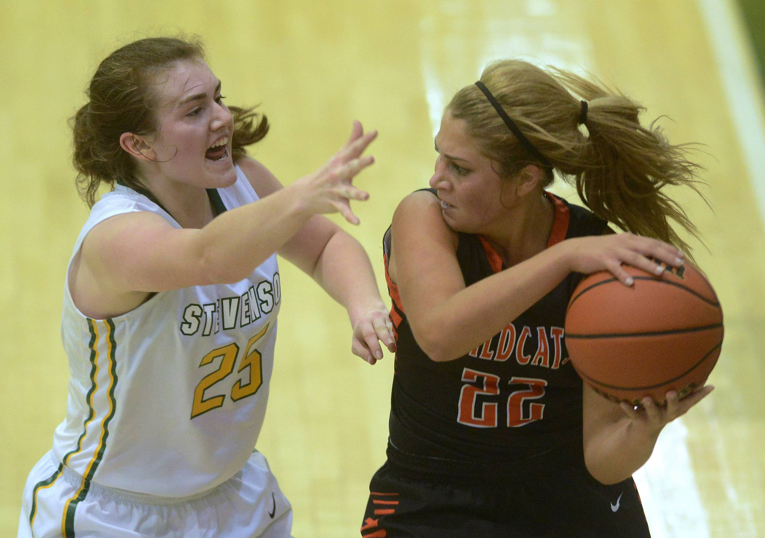 Stevenson's Ashley Richardson, left, plays tight defense on Libertyville's Riley Weis last season during a matchup in Lincolnshire.