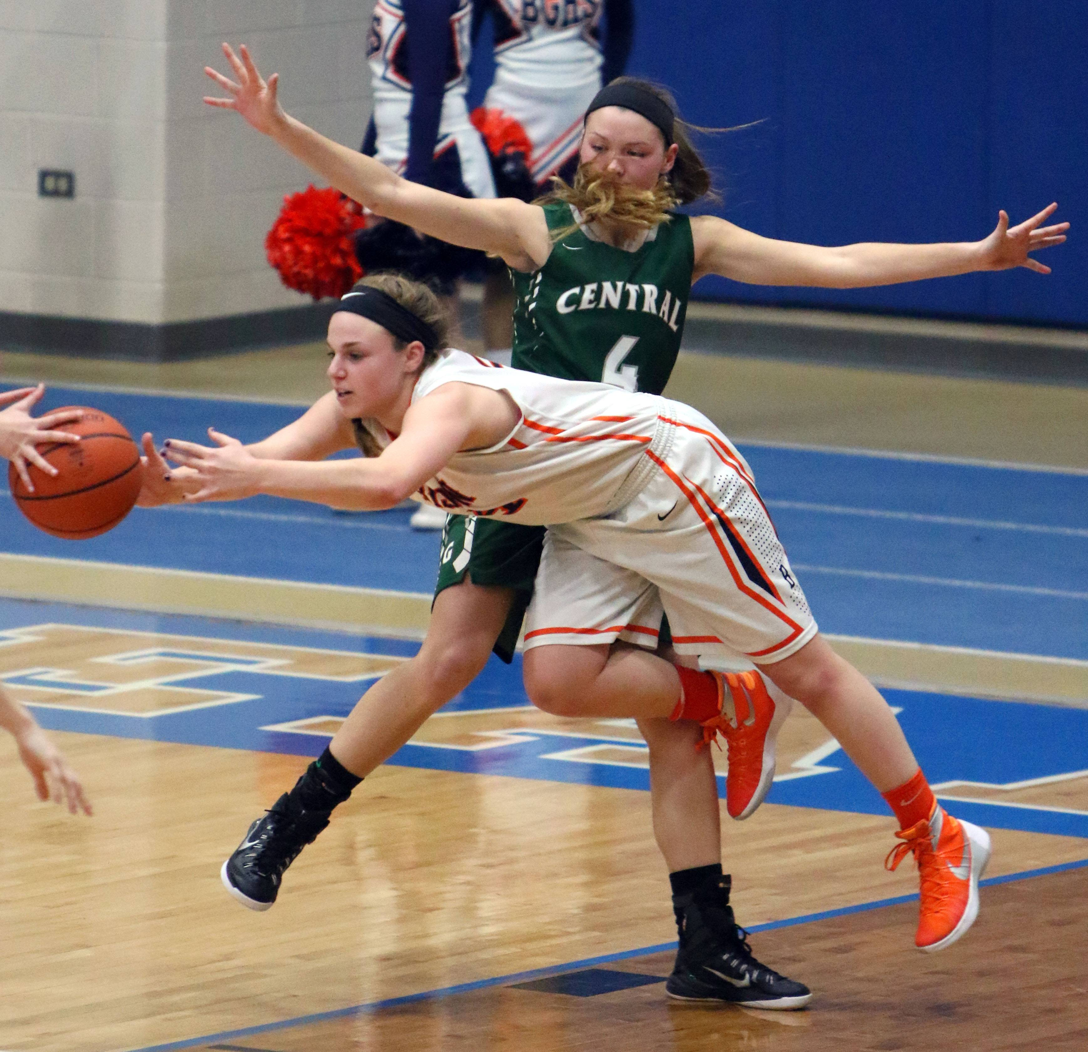 Buffalo Grove's Georgette Topalis battles around Grayslake Central defender Lindsay Brust during Class 4A regional semifinal play last season.