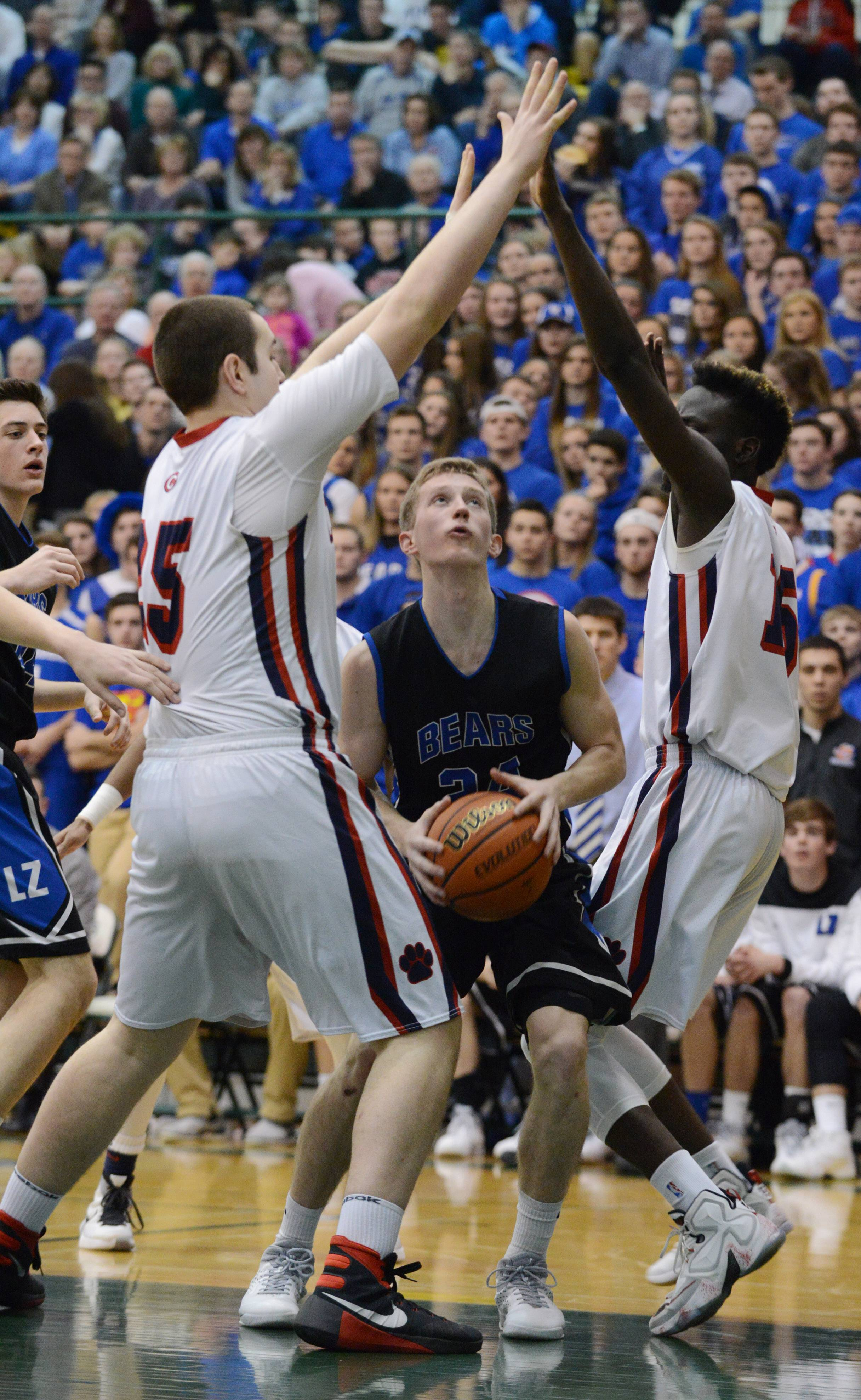 Conant's Ryan Davis, left, and Mike Downing, here defending against Lake Zurich's Nick Meyer in sectional final play last season, figure to make life difficult for the Cougars' Mid-Suburban West foes this in 2016-17.