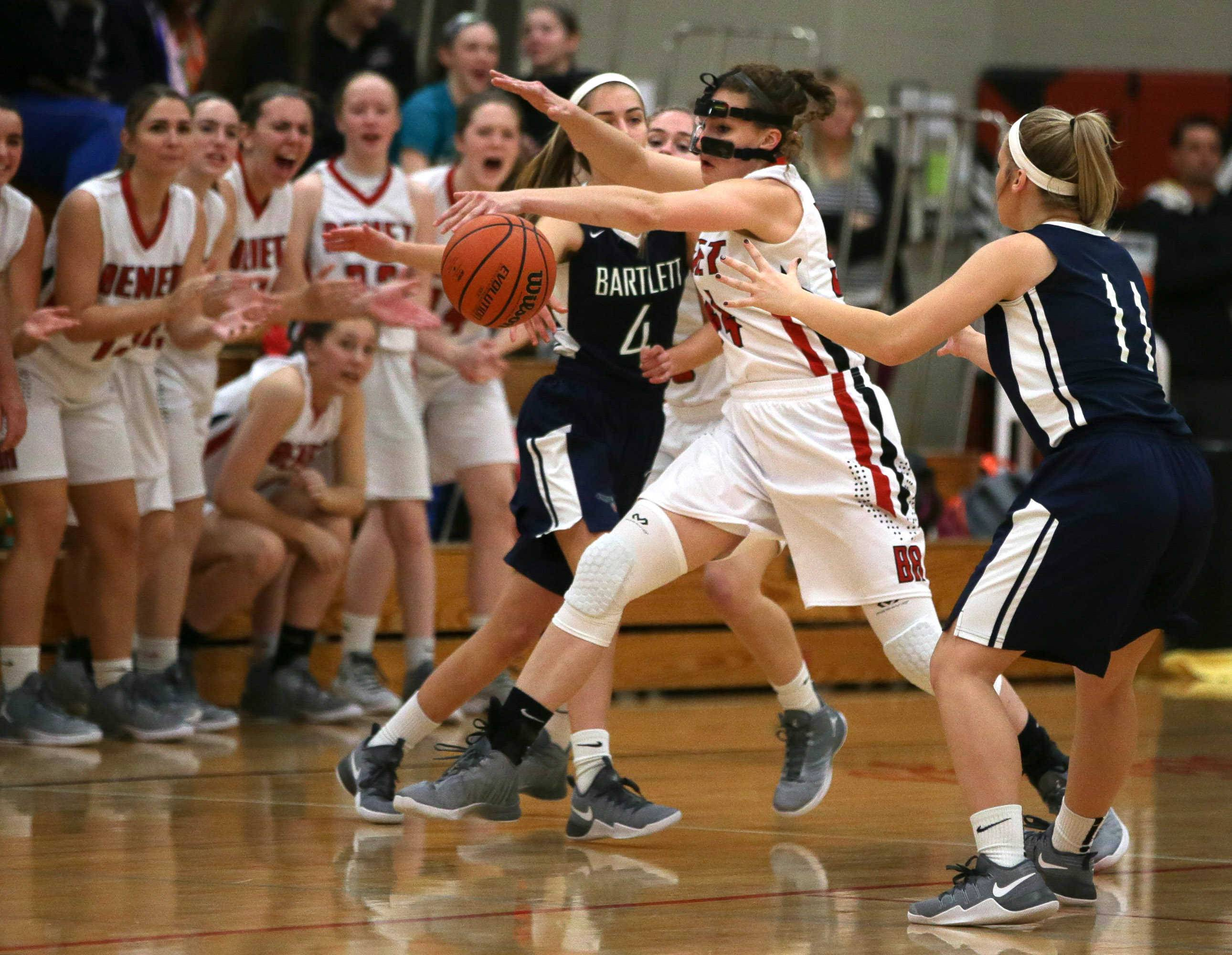Benet center Katherine Jaseckas (54) steals a pass against Bartlett guard Kayla Hare (4) at Benet Academy in Lisle, IL on Friday, November 18, 2016