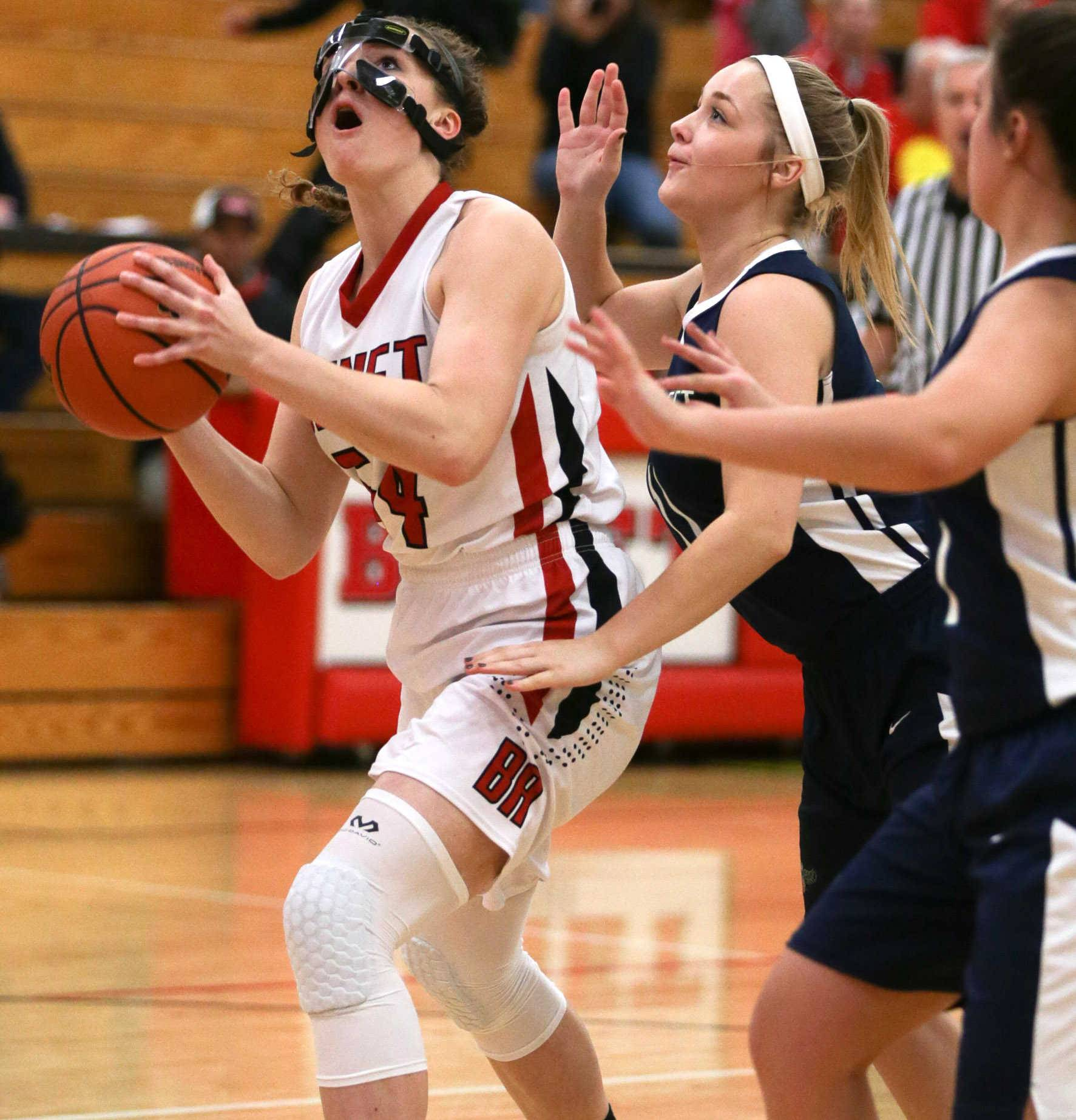 Benet center Katherine Jaseckas (54) plays the post against Bartlett forward Kasia Obrzud (11) at Benet Academy in Lisle, IL on Friday, November 18, 2016