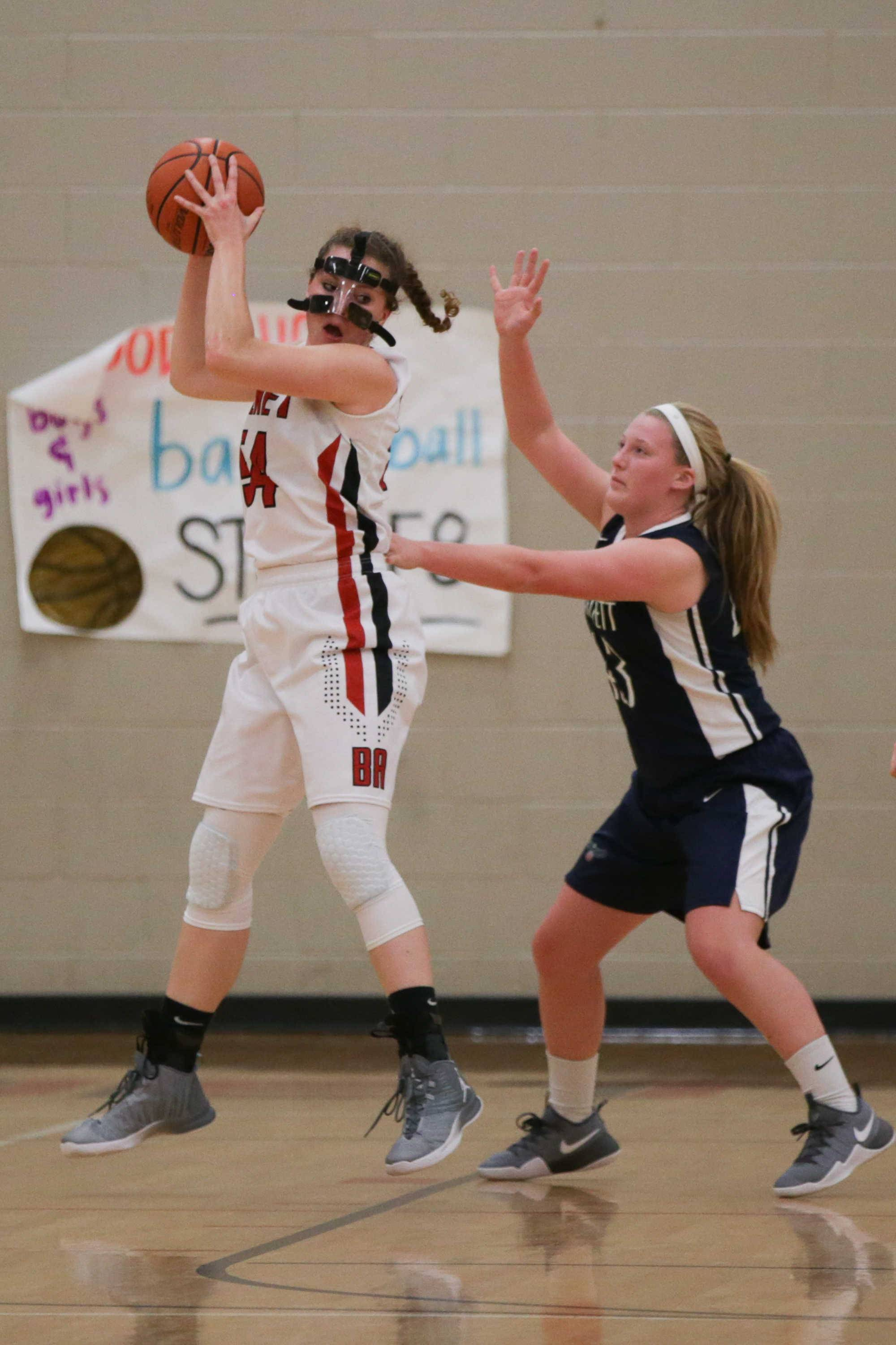 Benet center Katherine Jaseckas (54) plays the ball in the post against Bartlett Paige Bednarke (43) at Benet Academy in Lisle, IL on Friday, November 18, 2016