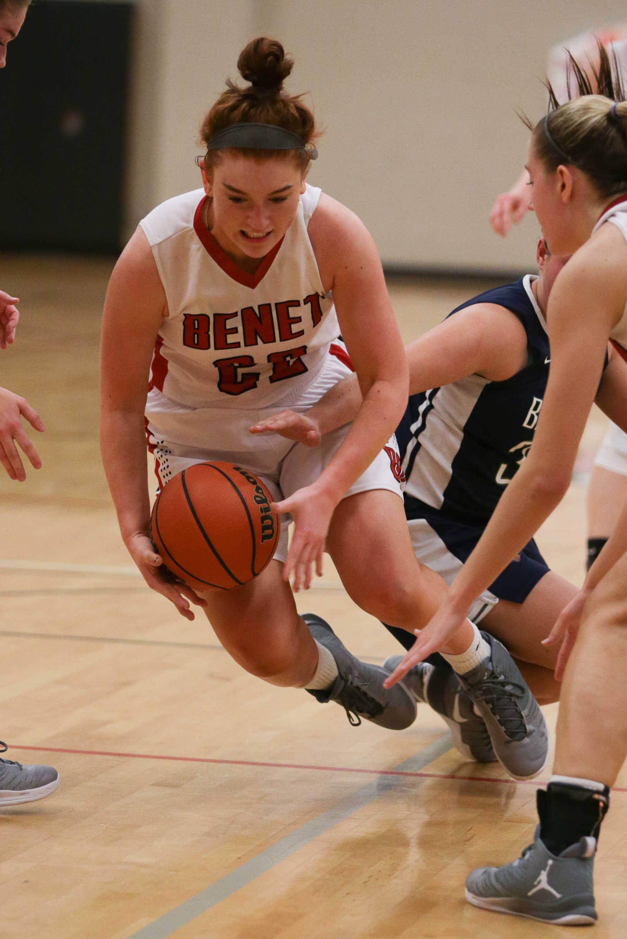 Sean King for the Daily Herald  Benet forward Kendal Schramek (22) dives for a loose ball against Bartlett at Benet Academy in Lisle, IL on Friday, November 18, 2016