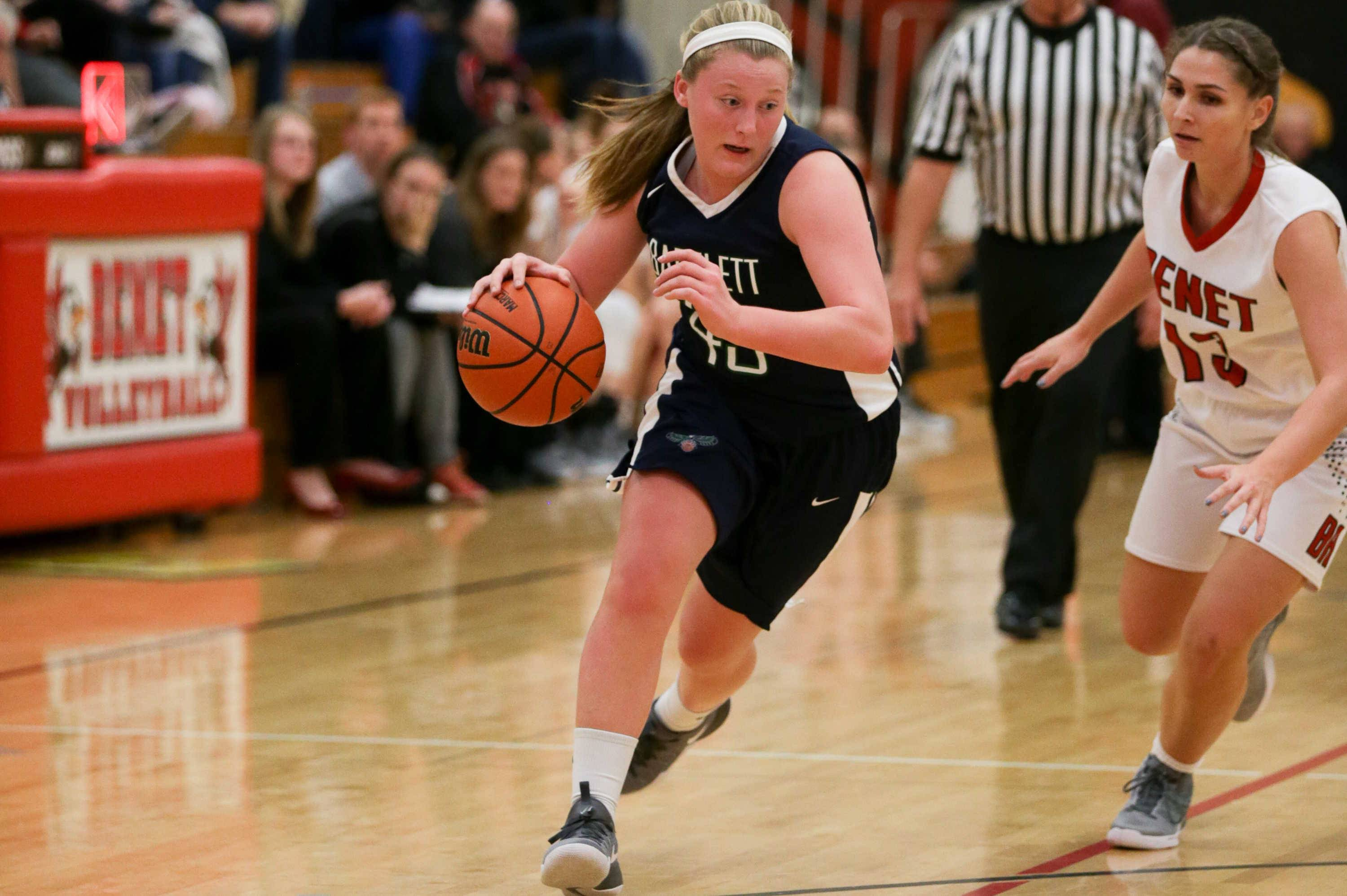 Bartlett Paige Bednarke (43) drives to the hoop against Benet forward Kate Heiberger (13) at Benet Academy in Lisle, IL on Friday, November 18, 2016