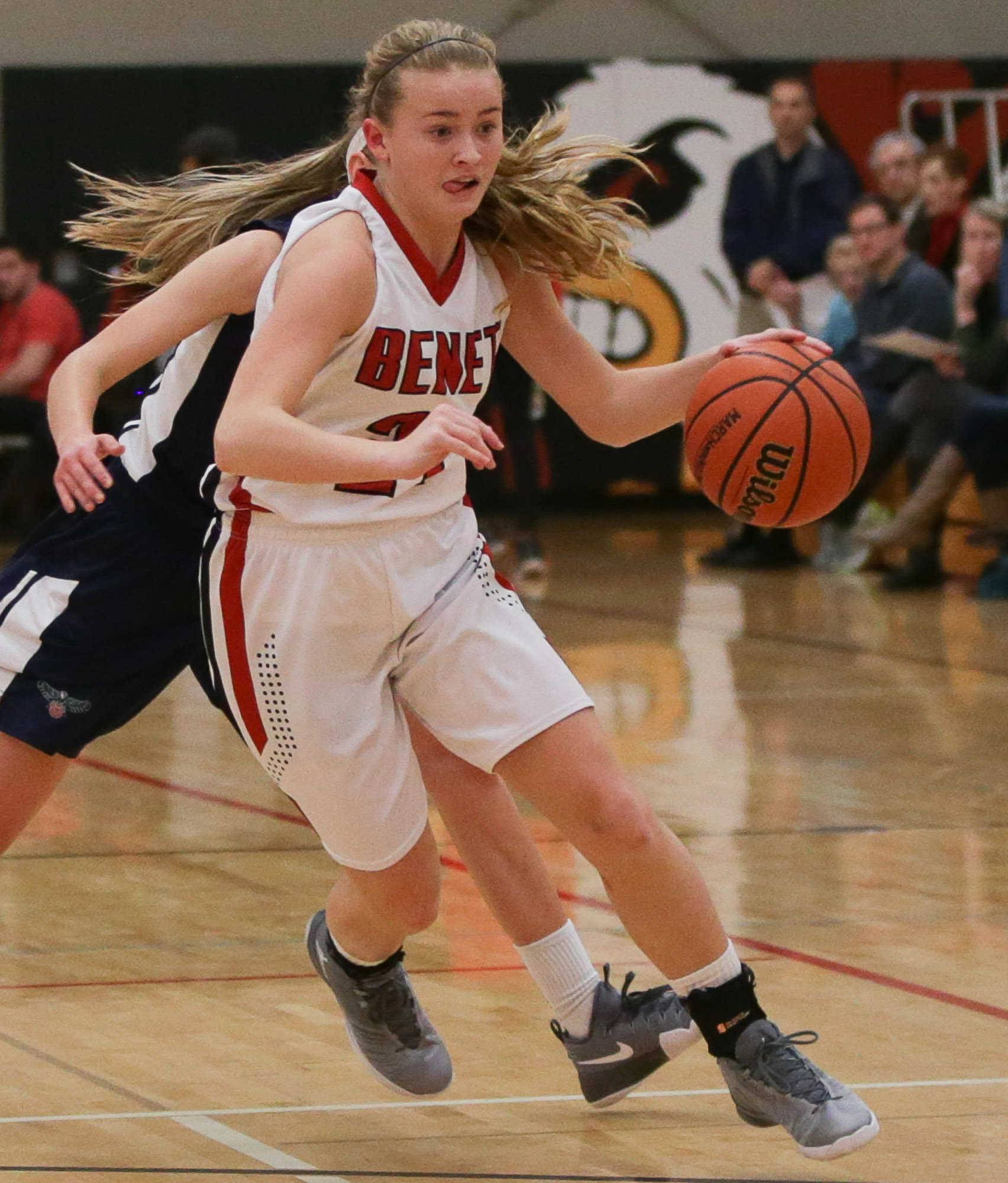 Benet guard Clara Prasse (21) brings the ball up the court past Bartlett guard Kayla Hare (4) at Benet Academy in Lisle, IL on Friday, November 18, 2016
