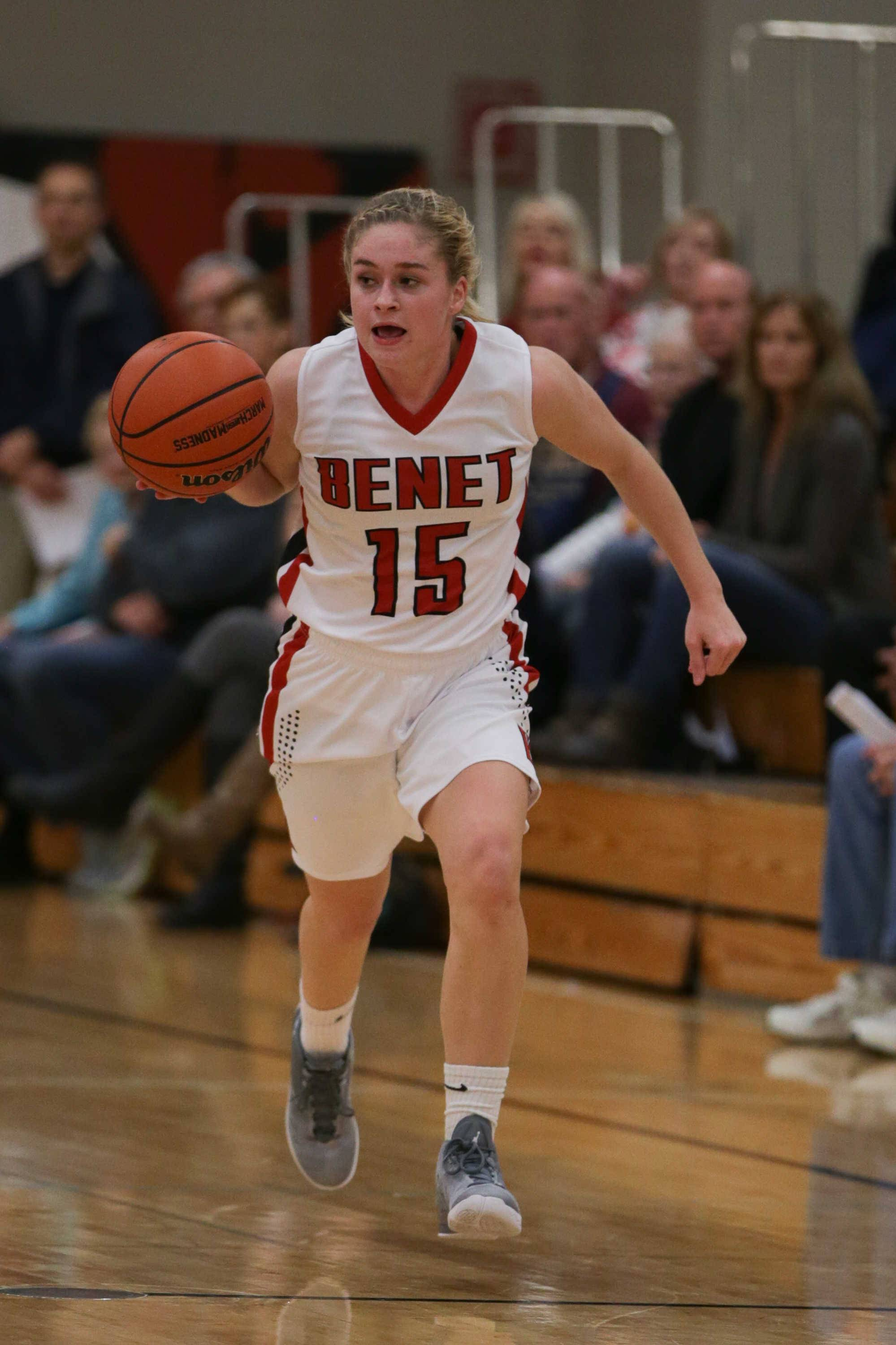 Benet guard Emma Lyne (15) moves the ball up the court against Bartlett at Benet Academy in Lisle, IL on Friday, November 18, 2016