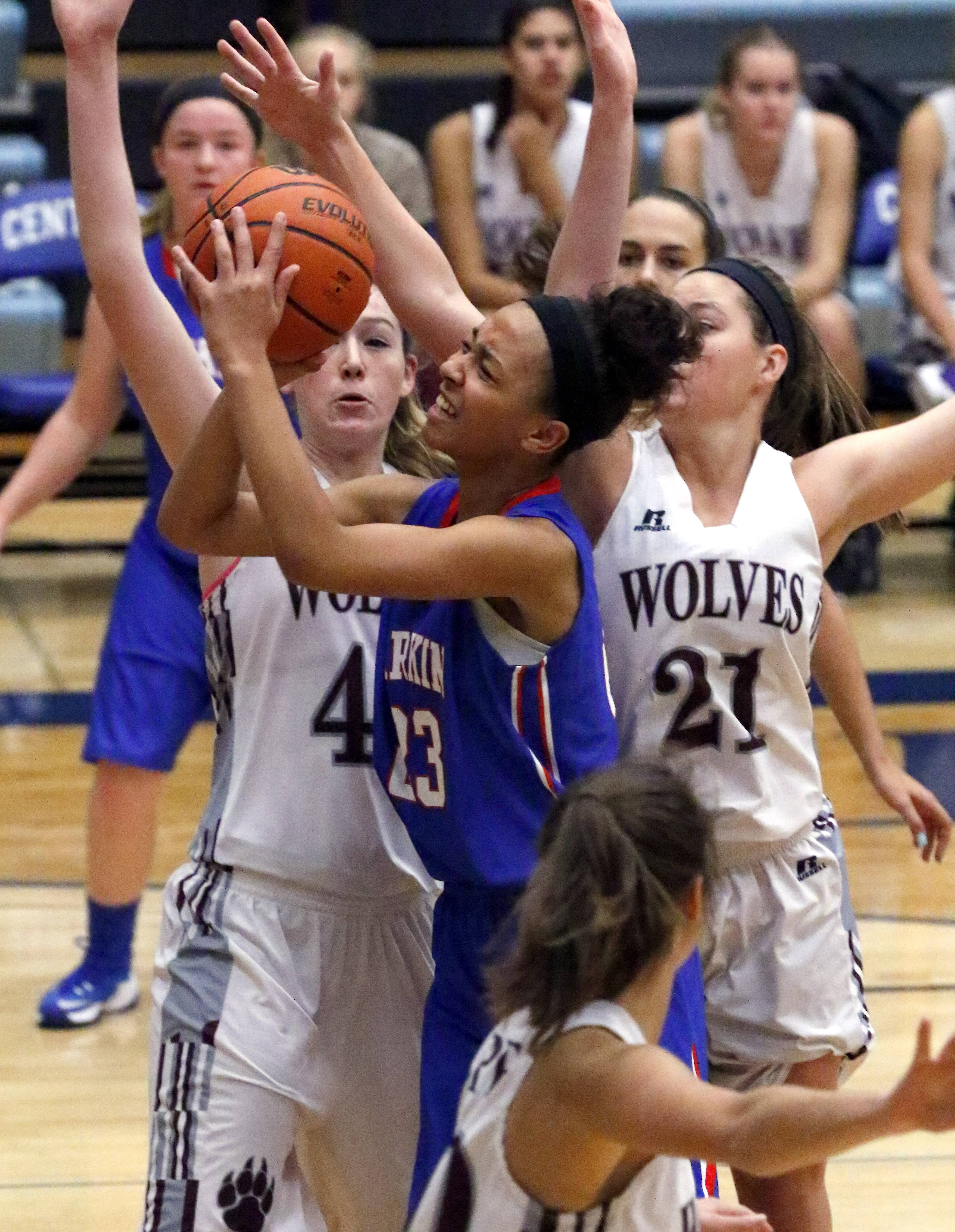 Larkin's Brianna Young is surrounded by a pack of Prairie Ridge Wolves as she drives to the basket during girls basketball Saturday at Burlington Central's Thanksgiving Classic Tournament.
