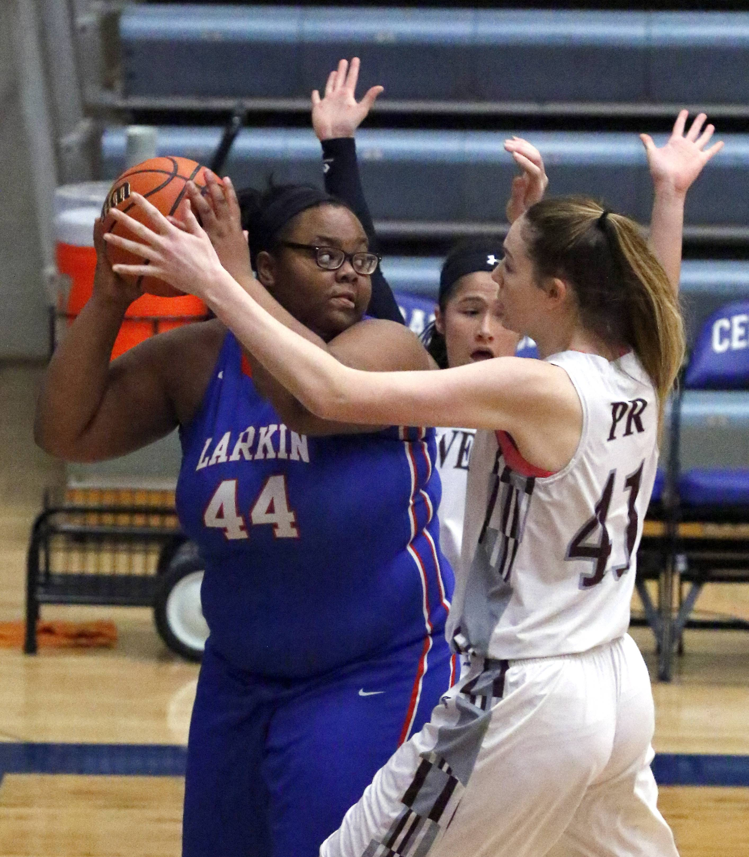 Larkin's Shawniece Colen-Douglas looks for an open teammate over Prairie Ridge players during girls basketball Saturday at Burlington Central's Thanksgiving Classic Tournament.