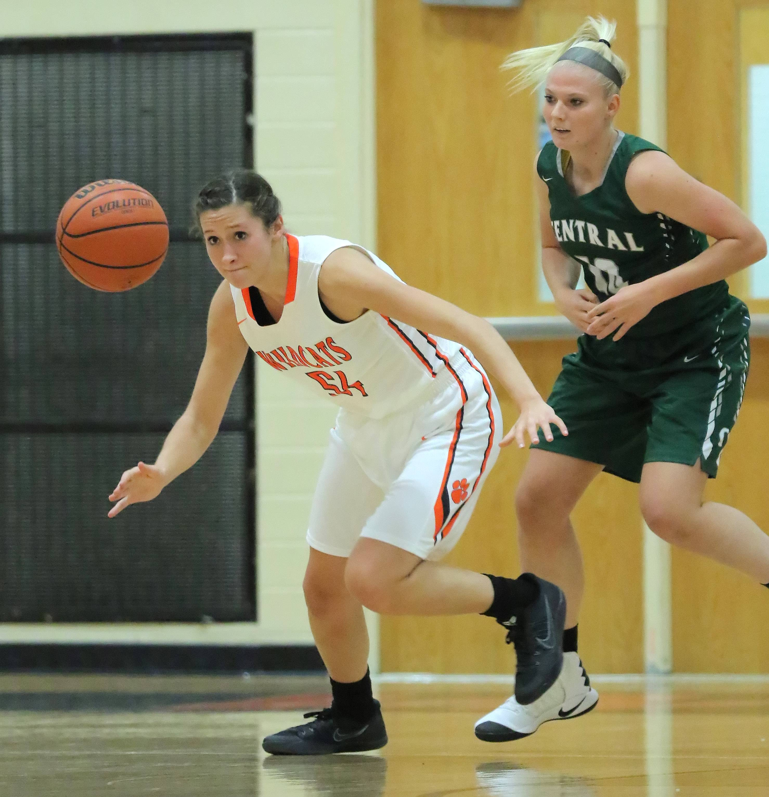 Libertyville's Claire Keefe, left, and Grayslake Central's Jordyn Gosell go for a rebound Tuesday night at Libertyville.