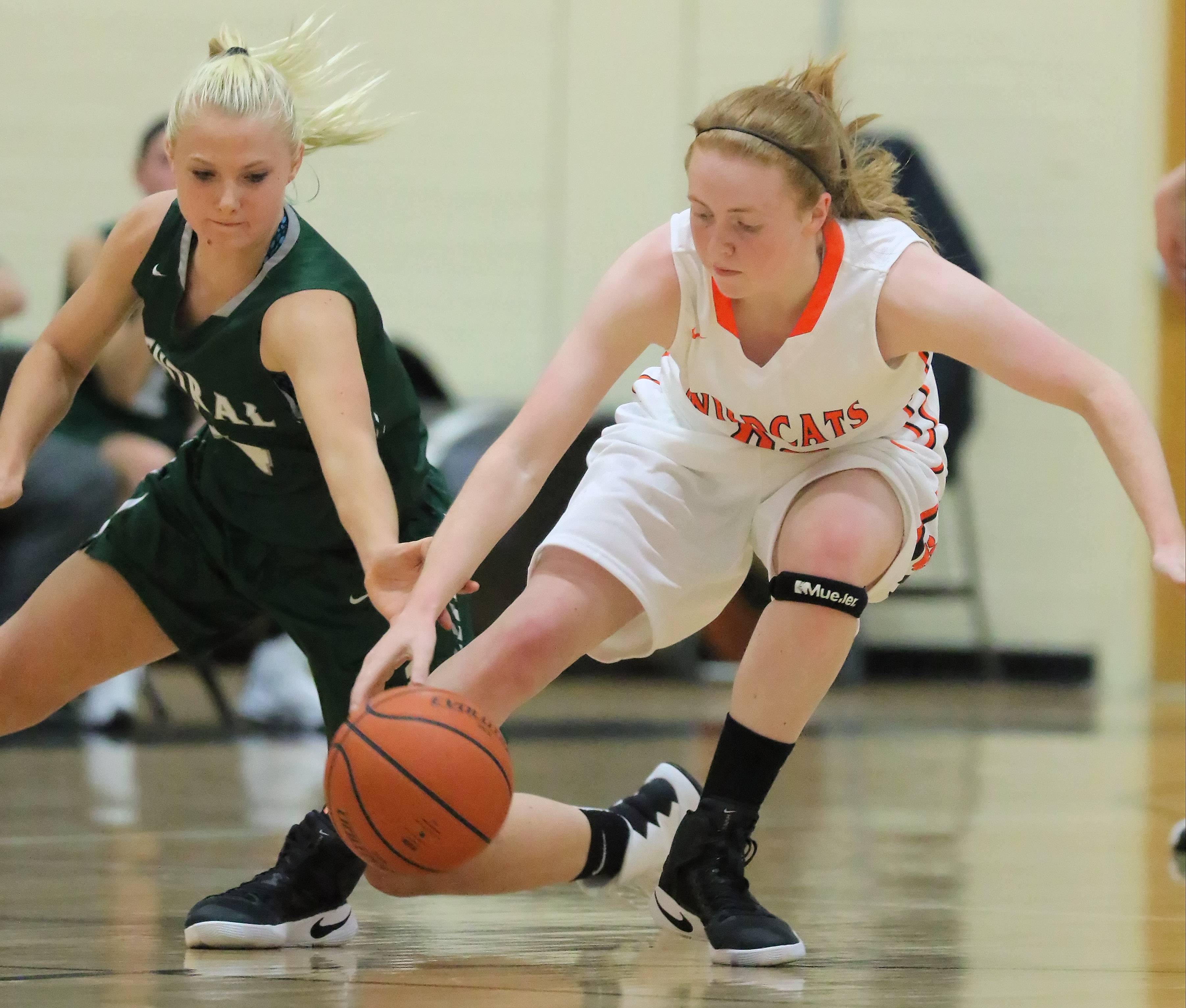 Grayslake Central's Payton Gosell, left, and Libertyville's Lydia Crow battle for a loose ball Tuesday night at Libertyville.