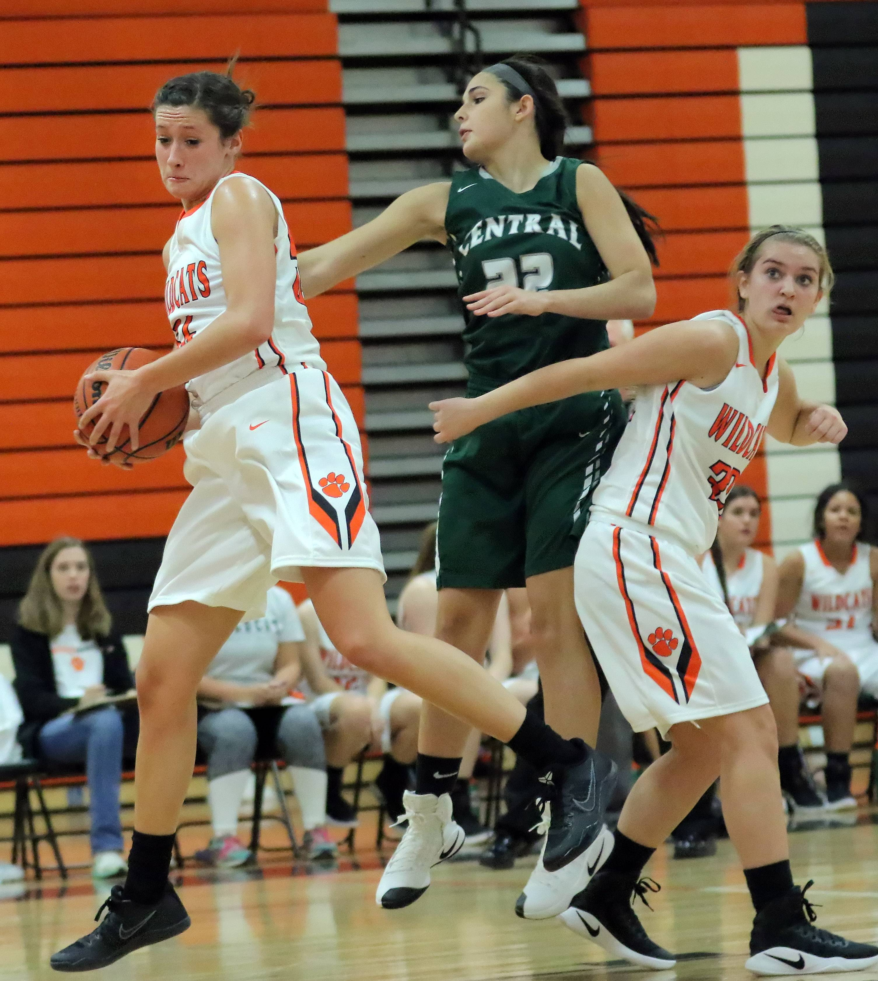 Libertyville's Claire Keefe, left, pulls down a rebound over Grayslake Central's Bitsy Erker on Tuesday night at Libertyville.