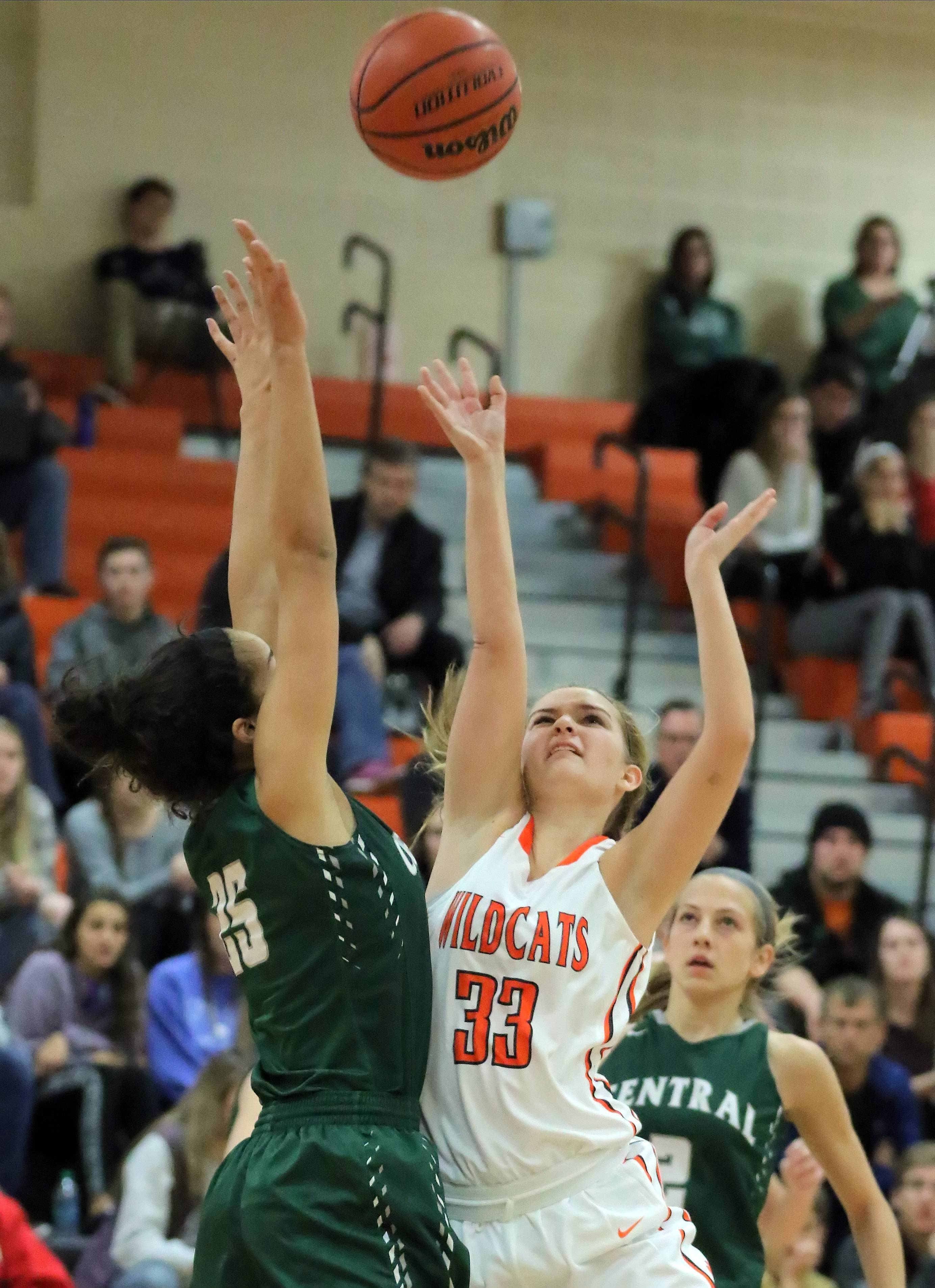 Libertyville's Morgan Manski, right, drives on Grayslake Central's Ania Barnes on Tuesday night at Libertyville.