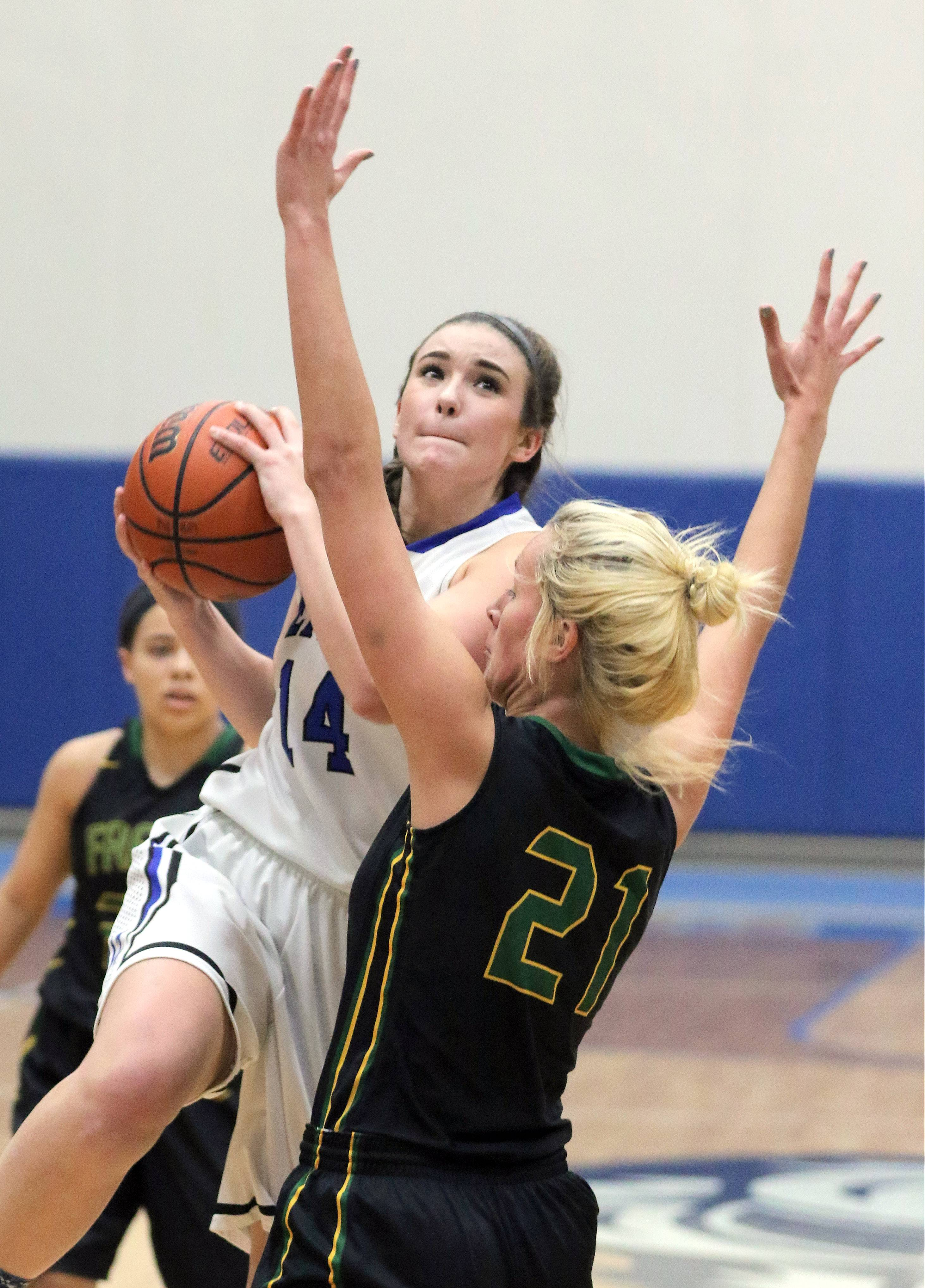 Lake Zurich's McKenna Zobel, left, drives on Fremd's Grace Tworek on Wednesday night at Lake Zurich.