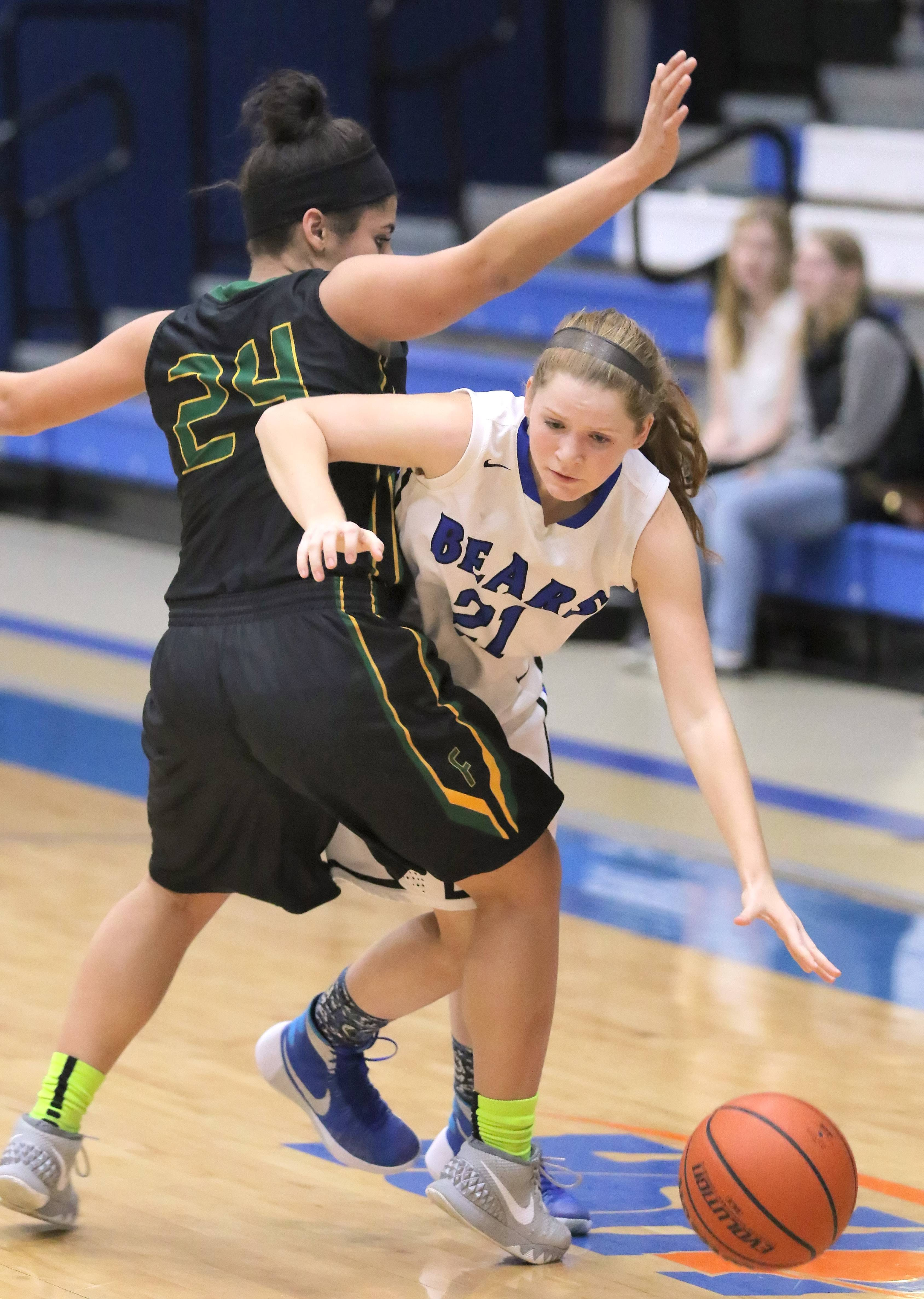 Lake Zurich's Anna Biergans, right, tries to get around Fremd's Midori Williams on Wednesday night at Lake Zurich.