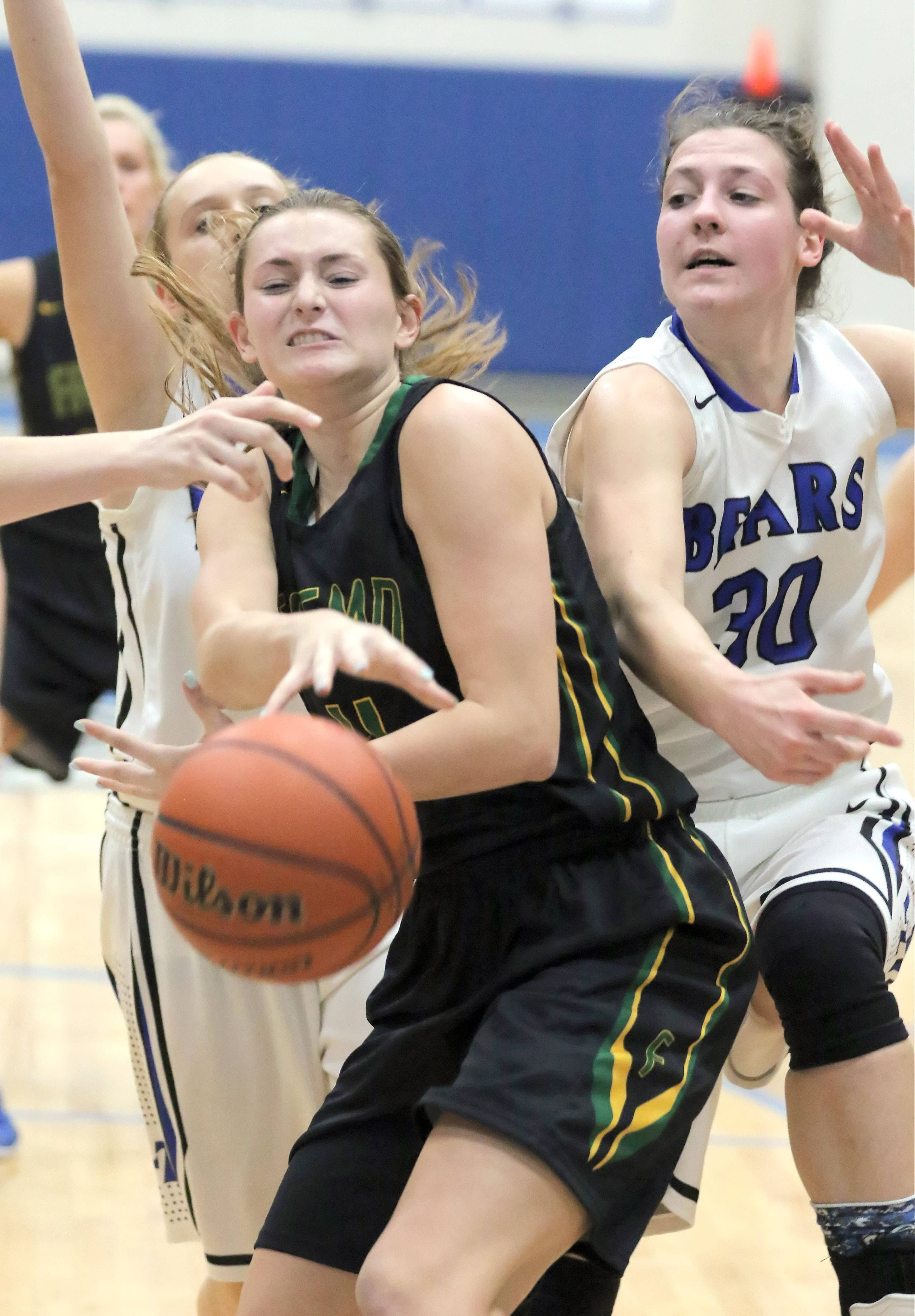 Fremd's Missy Adrian, left, and Lake Zurich's Grace Kinsey battle for a rebound Wednesday night at Lake Zurich.