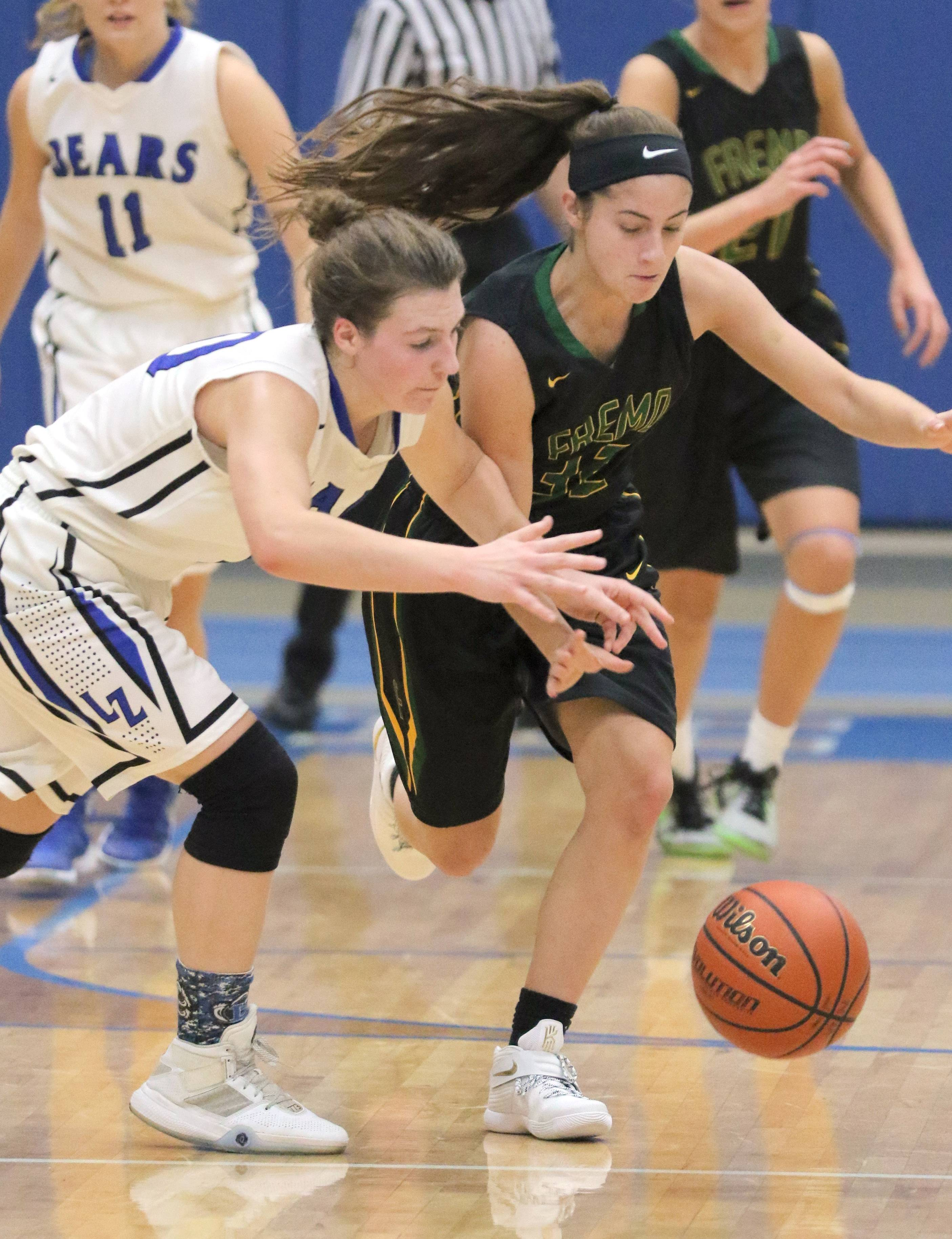Lake Zurich's Grace Kinsey, left, and Fremd's Angie Zara battle for a loose ball Wednesday night at Lake Zurich.