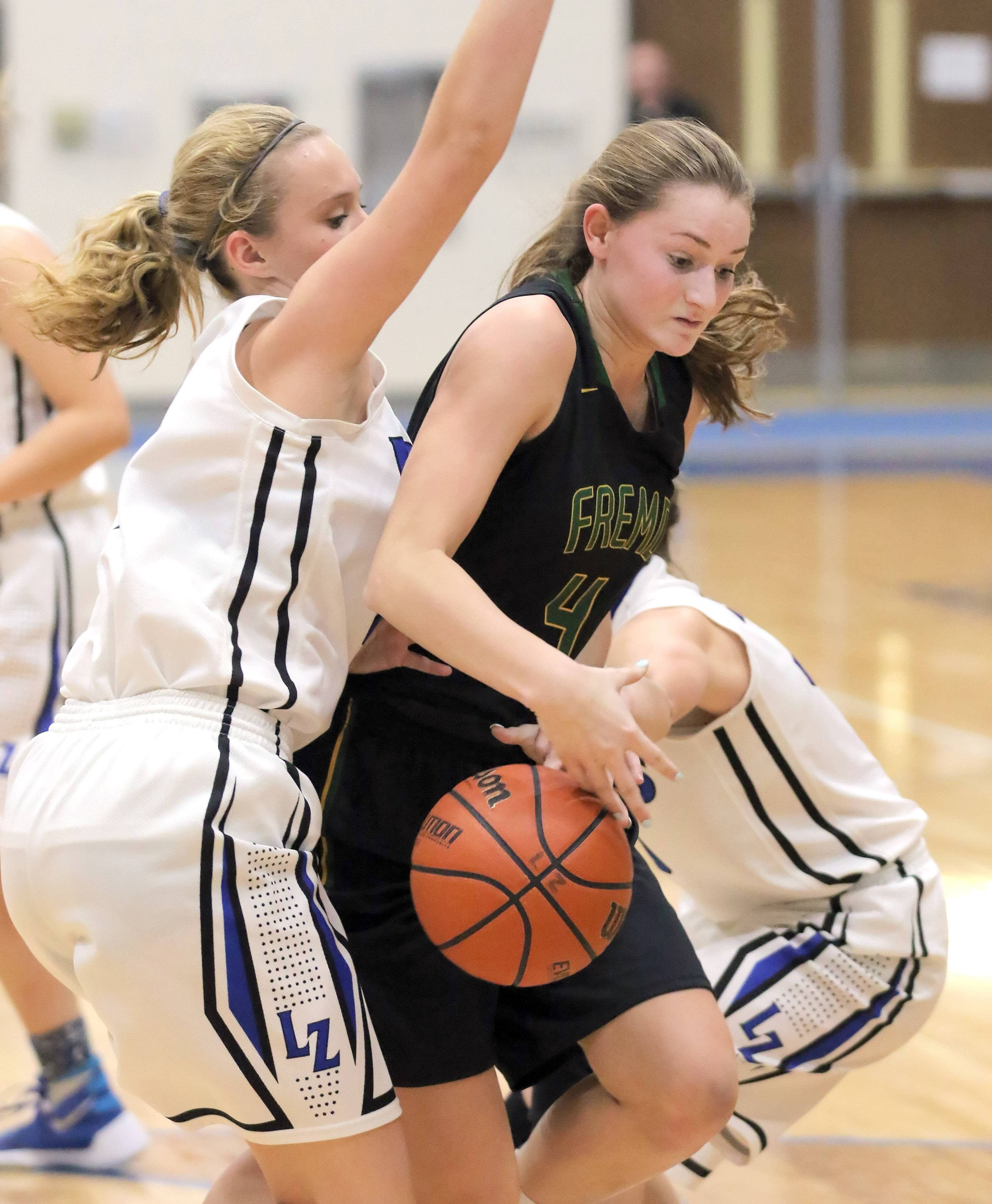 Fremd's Missy Adrian, right, drives on Lake Zurich's Lauryn Johnson on Wednesday night at Lake Zurich.