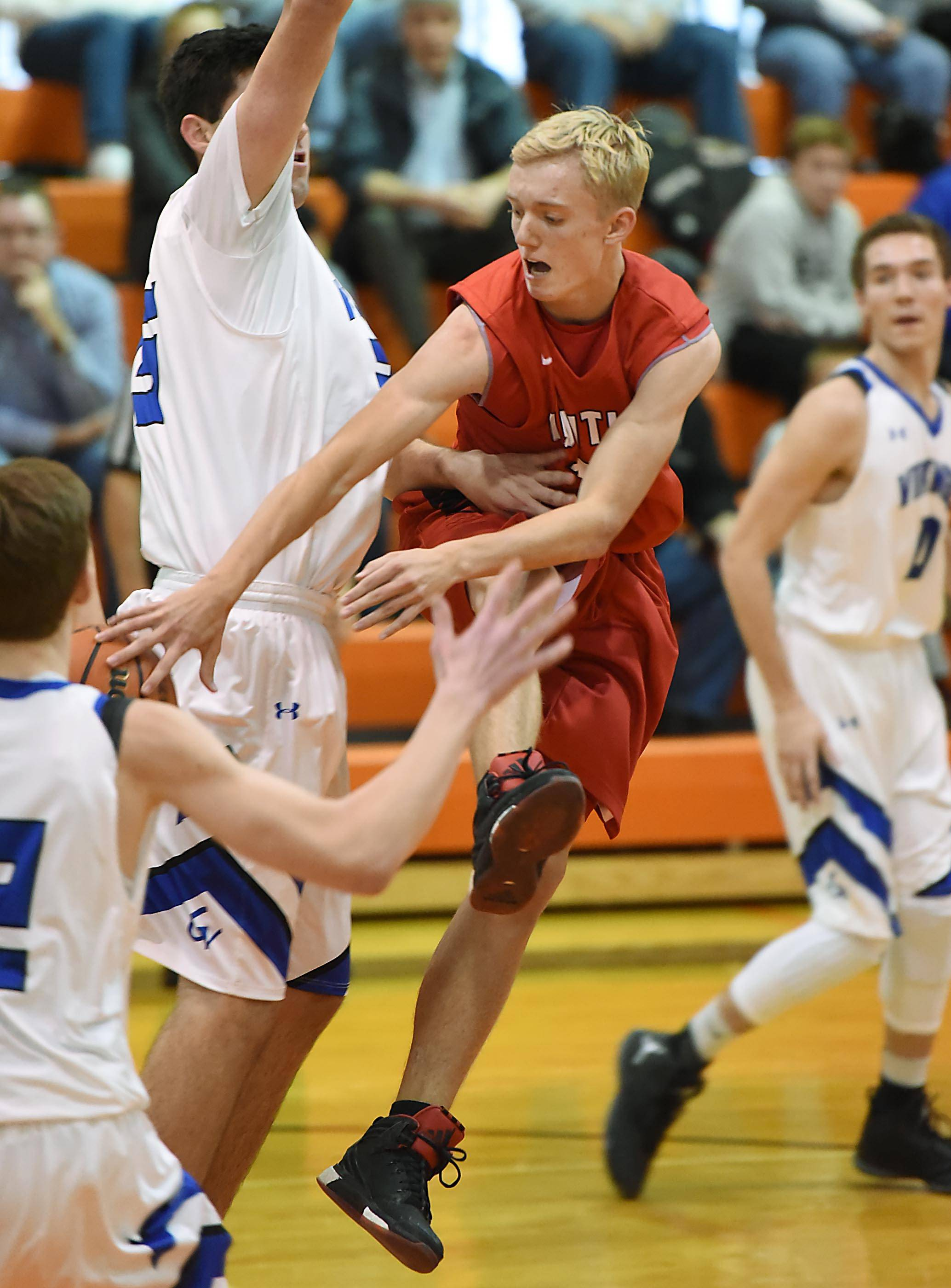 Huntley's Cory Knipp makes a pass around Geneva's Dom Navigato Wednesday at Crystal Lake Central High School.