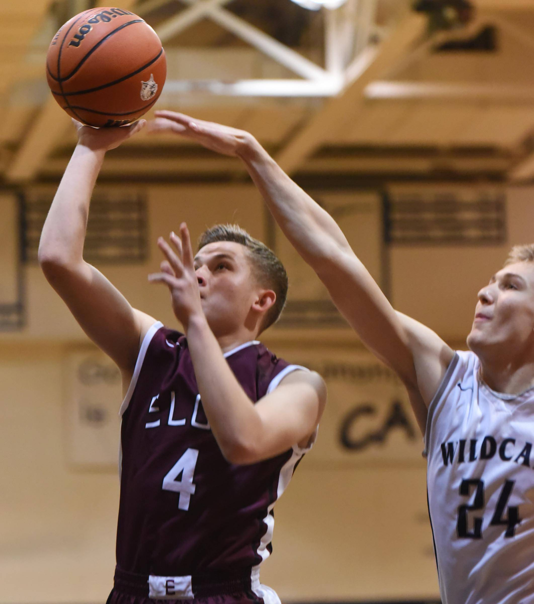 West Chicago's Alen Mahmic tries to block a shot by Elgin's Timothy Wolf Saturday in West Chicago.