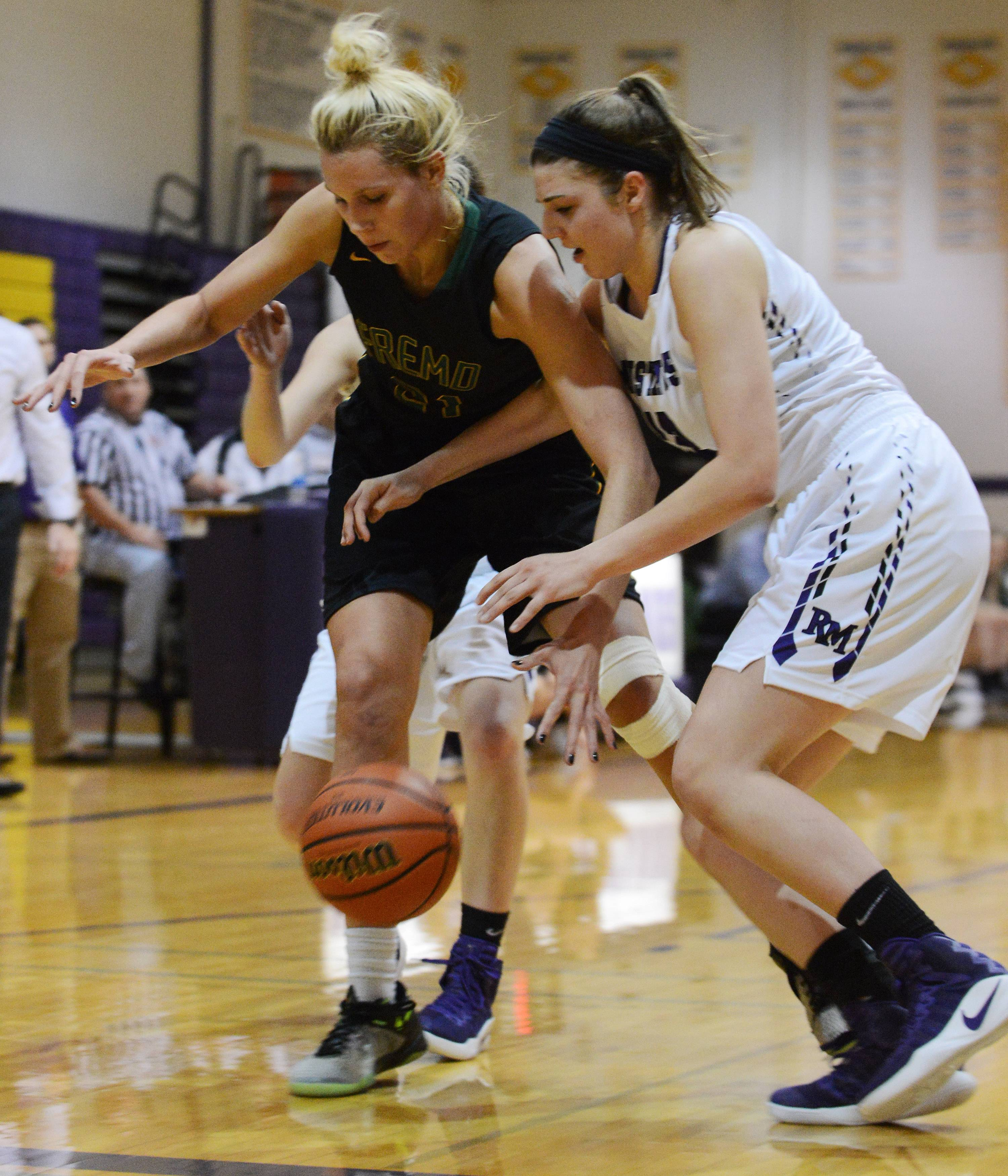 Fremd's Grace Tworek, left, and Rolling Meadows' Morgan Campagna chase a loose ball Tuesday.